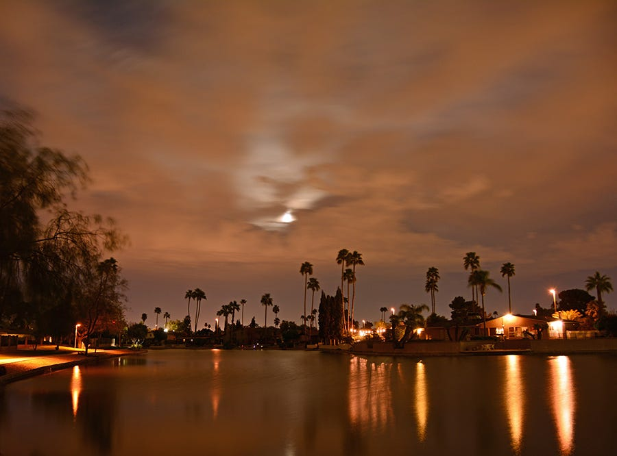 Supermoon on a cloudy night at Dobson Ranch Lake.