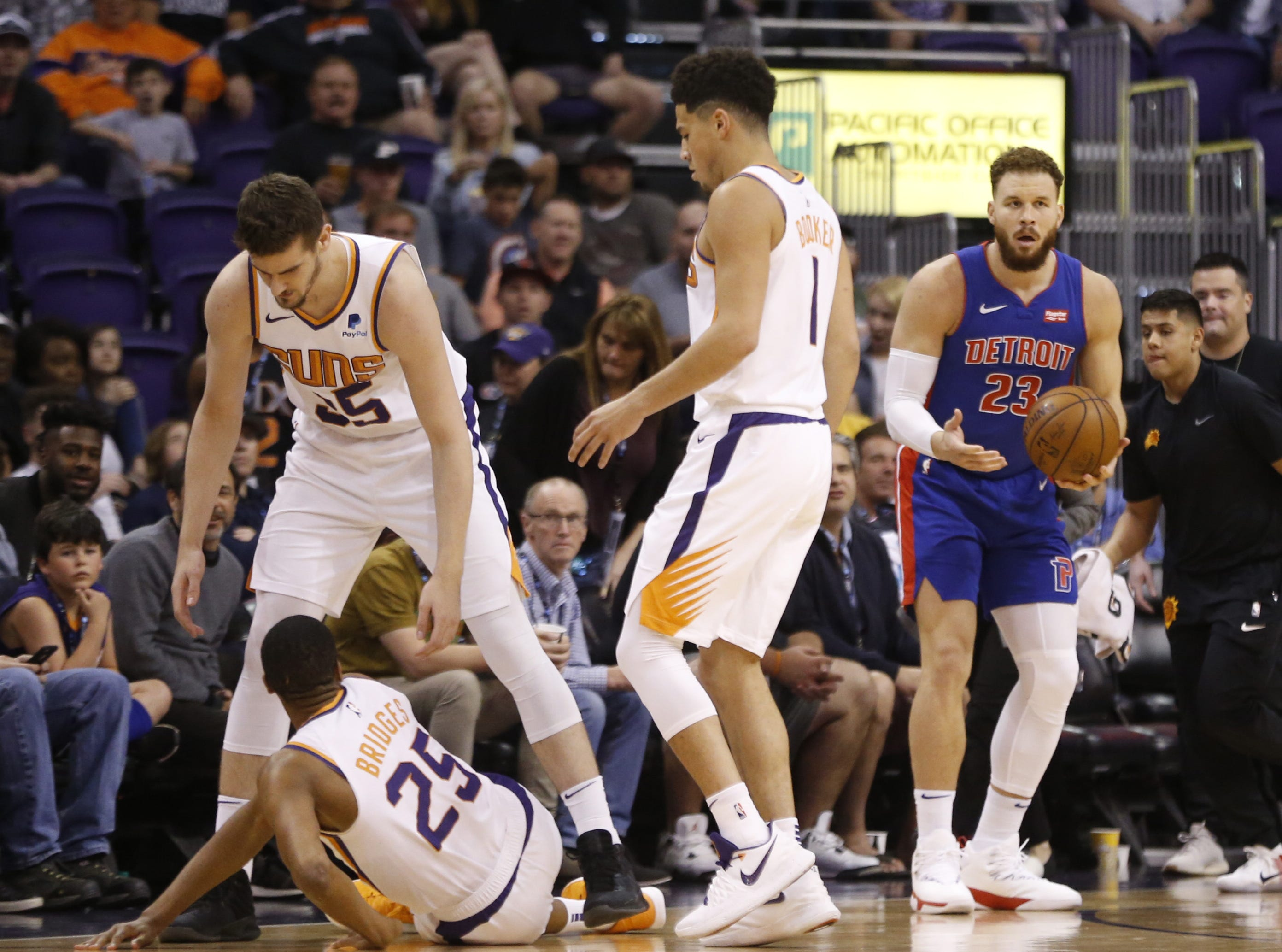 Detroit Pistons forward Blake Griffin (23) reacts after being called for an offensive foul against the Suns' Mikal Bridges (25) during the second half of a game at Talking Stick Resort Arena.