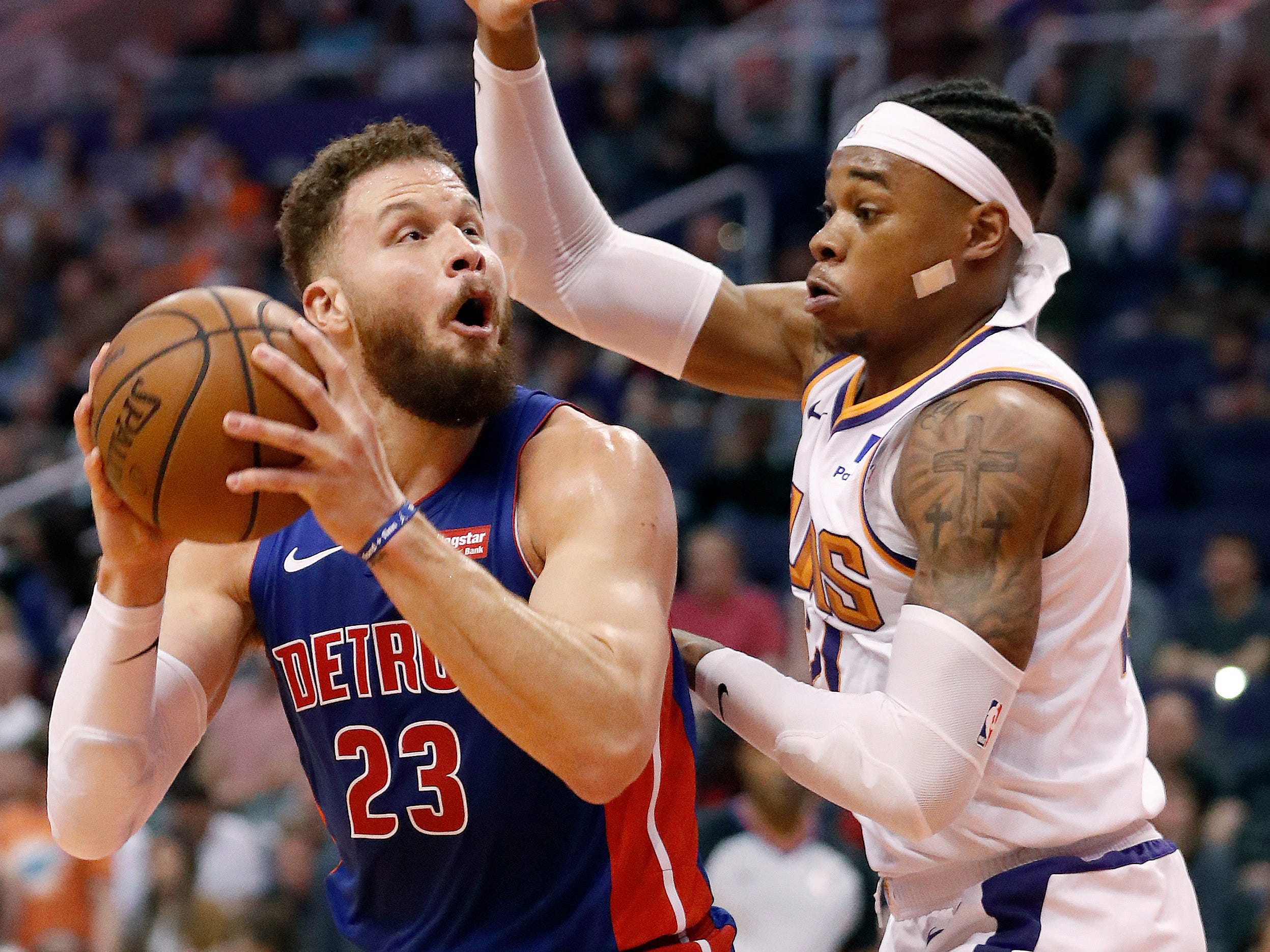 Detroit Pistons forward Blake Griffin (23) shoots over Phoenix Suns forward Richaun Holmes during the first half of an NBA basketball game, Thursday, March 21, 2019, in Phoenix.