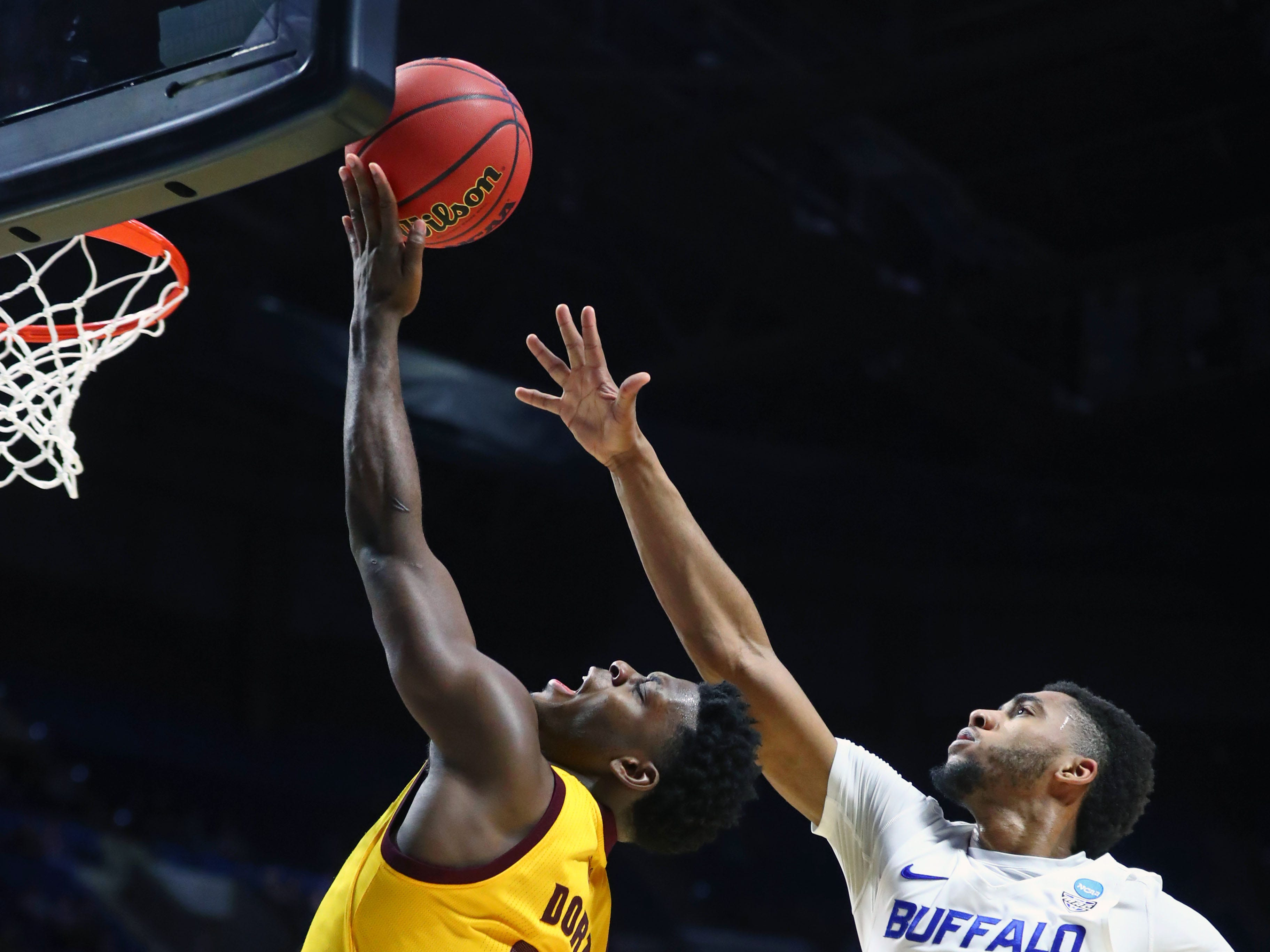 Mar 22, 2019; Tulsa, OK, USA; Arizona State Sun Devils guard Luguentz Dort (0) shoots while defended by Buffalo Bulls guard Jayvon Graves (3) during the first half in the first round of the 2019 NCAA Tournament at BOK Center. Mandatory Credit: Mark J. Rebilas-USA TODAY Sports