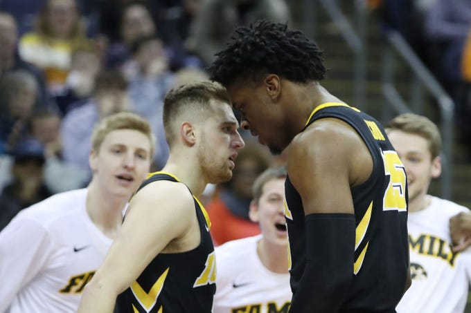 Iowa Hawkeyes guard Jordan Bohannon (3) and forward Tyler Cook (25) celebrate a play in the second half against the Cincinnati Bearcats in the first round of the 2019 NCAA Tournament at Nationwide Arena on March 22, 2019.