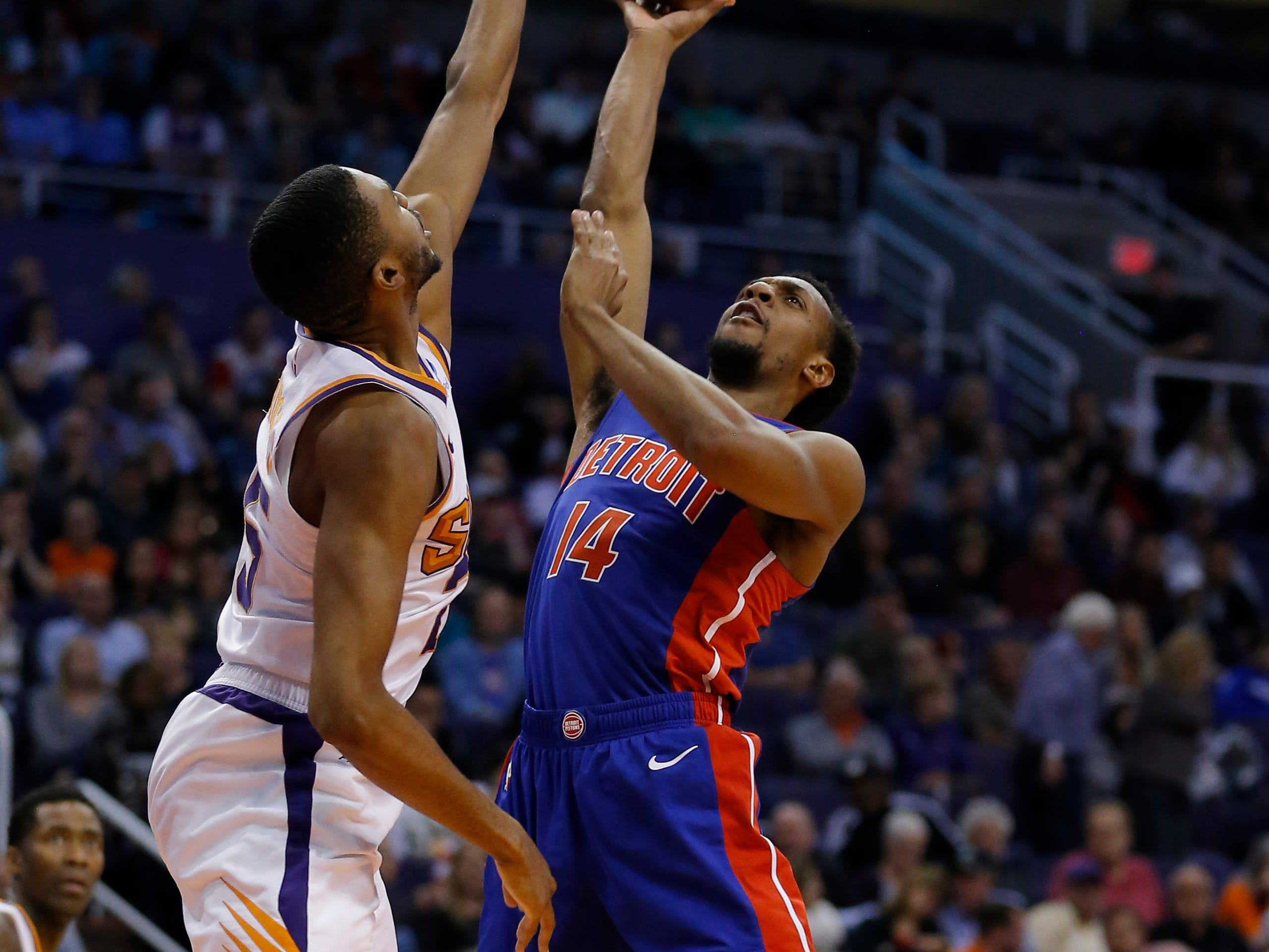 Mar 21, 2019; Phoenix, AZ, USA; Detroit Pistons guard Ish Smith (14) drives against Phoenix Suns forward Mikal Bridges (25) in the second half during an NBA basketball game at Talking Stick Resort Arena.