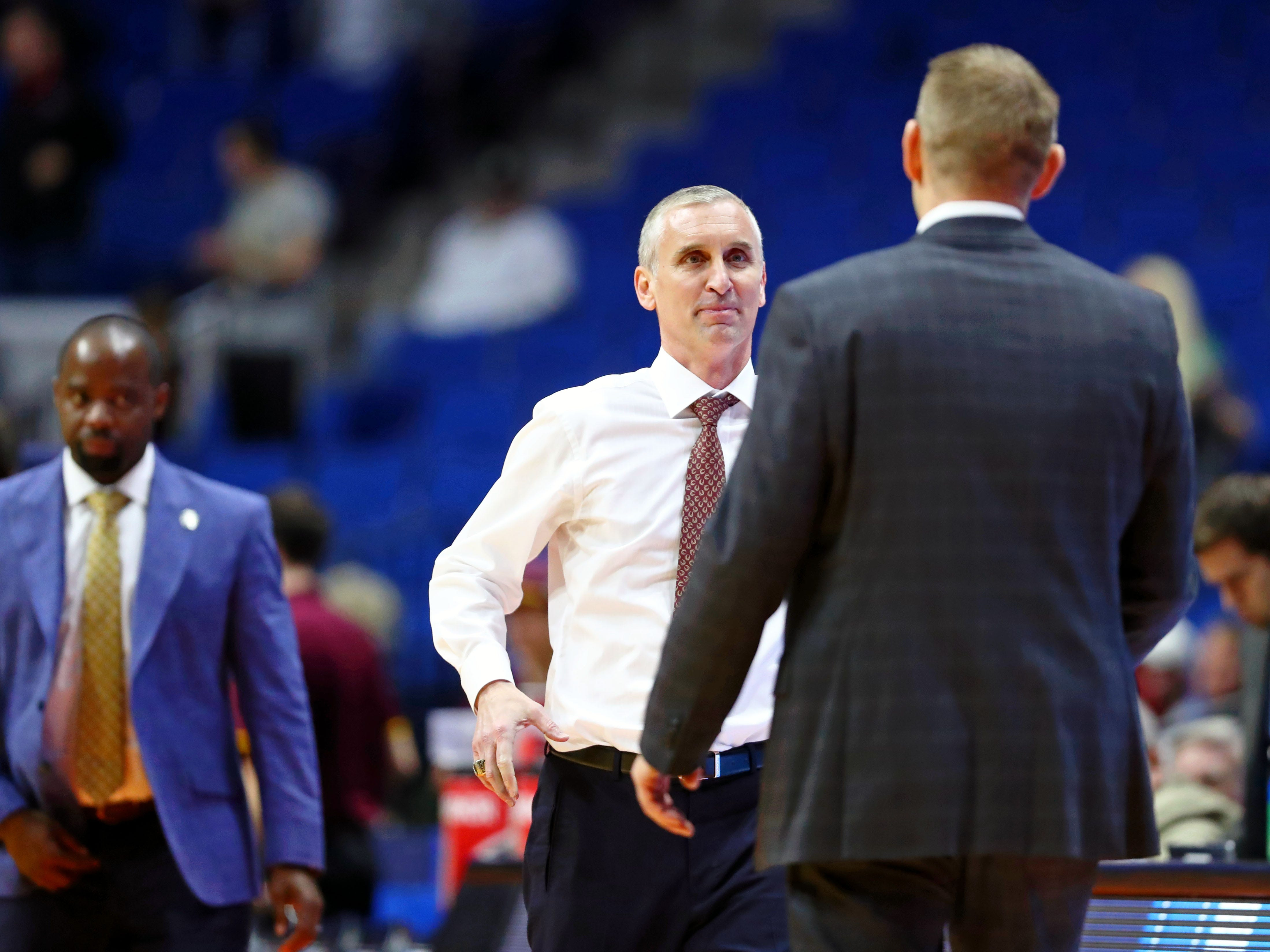 Mar 22, 2019; Tulsa, OK, USA; Arizona State Sun Devils head coach Bobby Hurley shakes hands with Buffalo Bulls head coach Nate Oats after their game in the first round of the 2019 NCAA Tournament at BOK Center. The Buffalo Bulls won 91-74. Mandatory Credit: Mark J. Rebilas-USA TODAY Sports