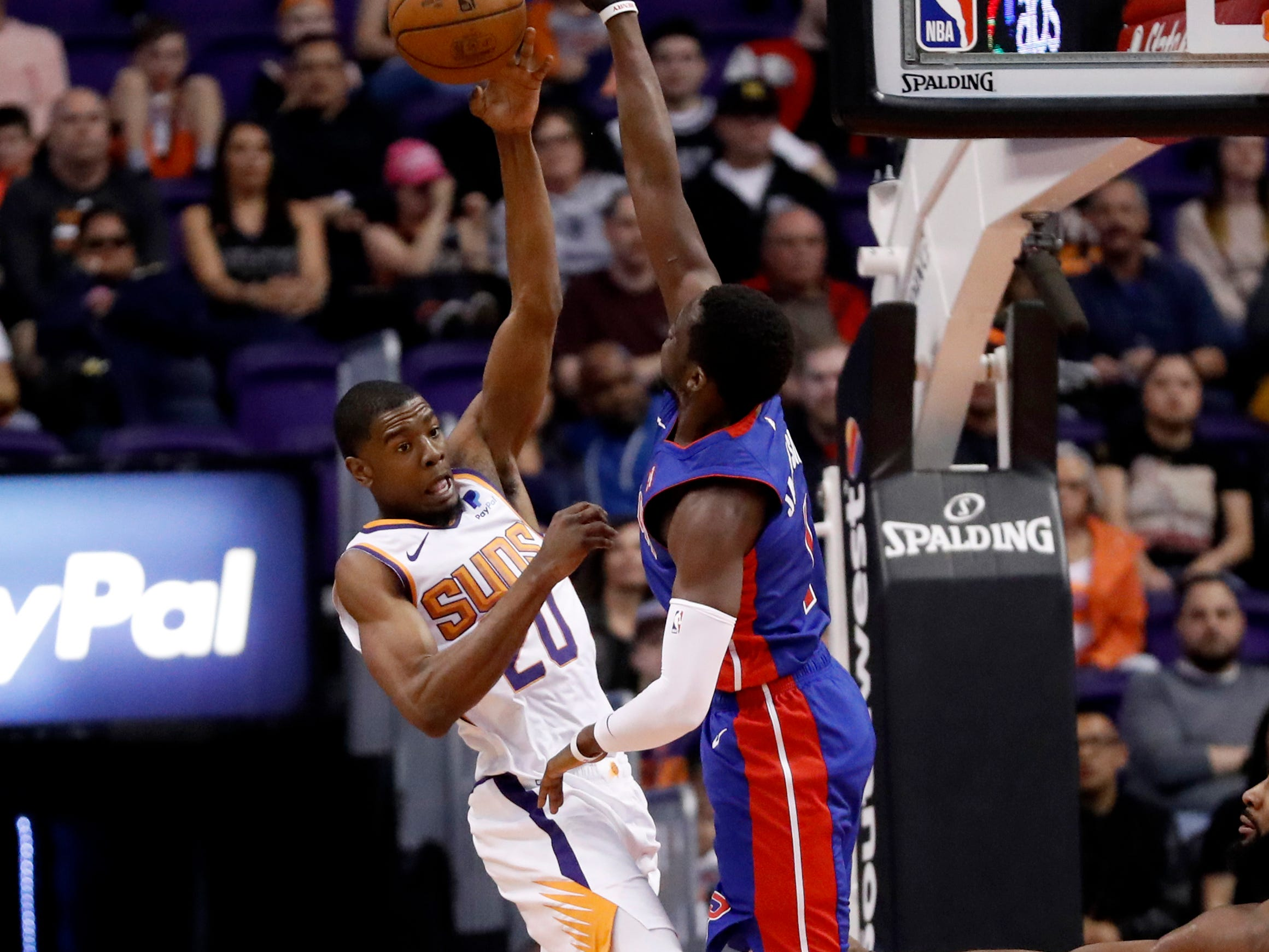 Phoenix Suns forward Josh Jackson (20) passes the ball over Detroit Pistons center Andre Drummond during the first half of an NBA basketball game Thursday, March 21, 2019, in Phoenix.