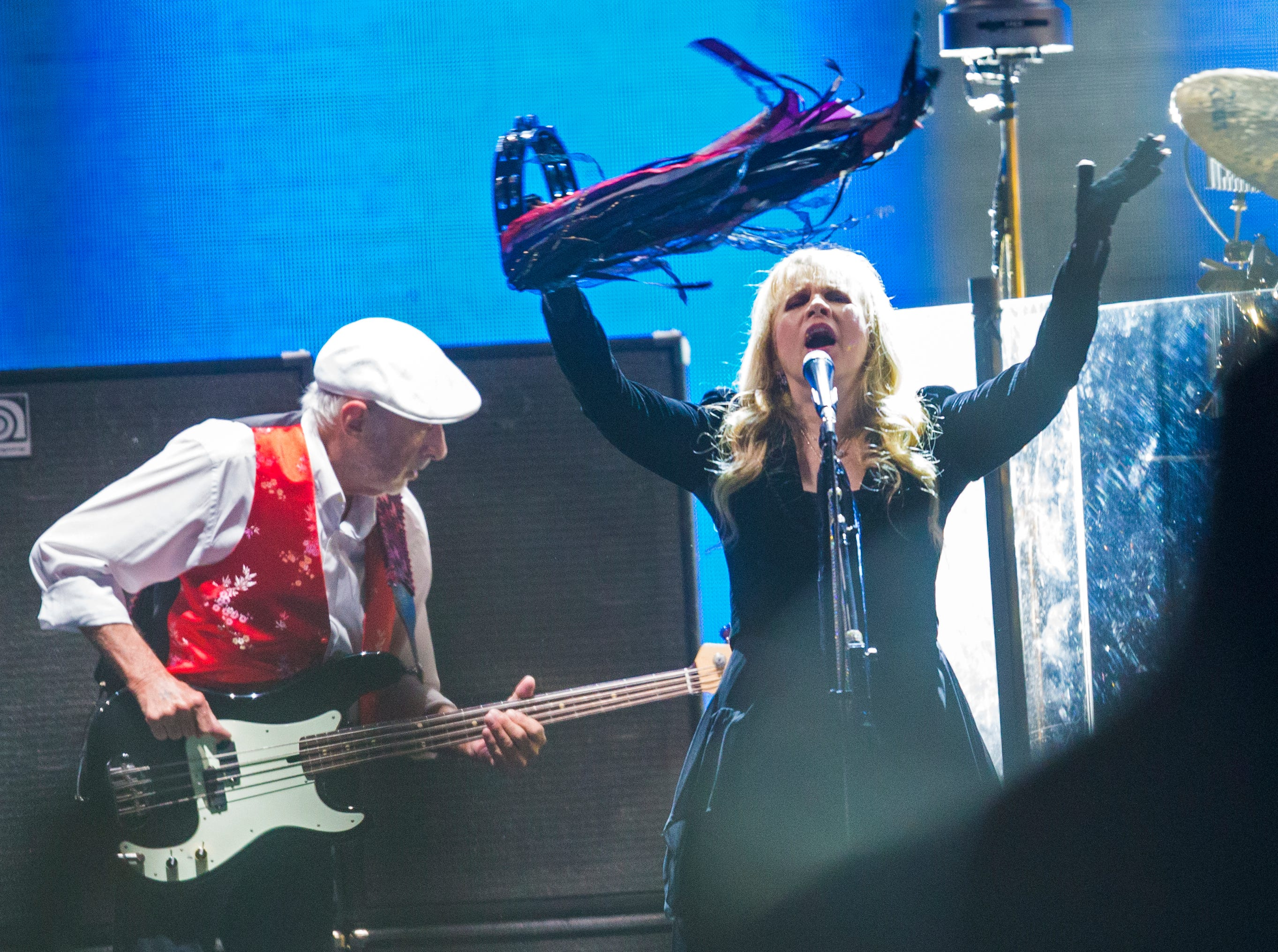 John McVie and Stevie Nicks perform with Fleetwood Mac during a concert at U.S. Airways Center in Phoenix, Ariz. Dec. 10, 2014.