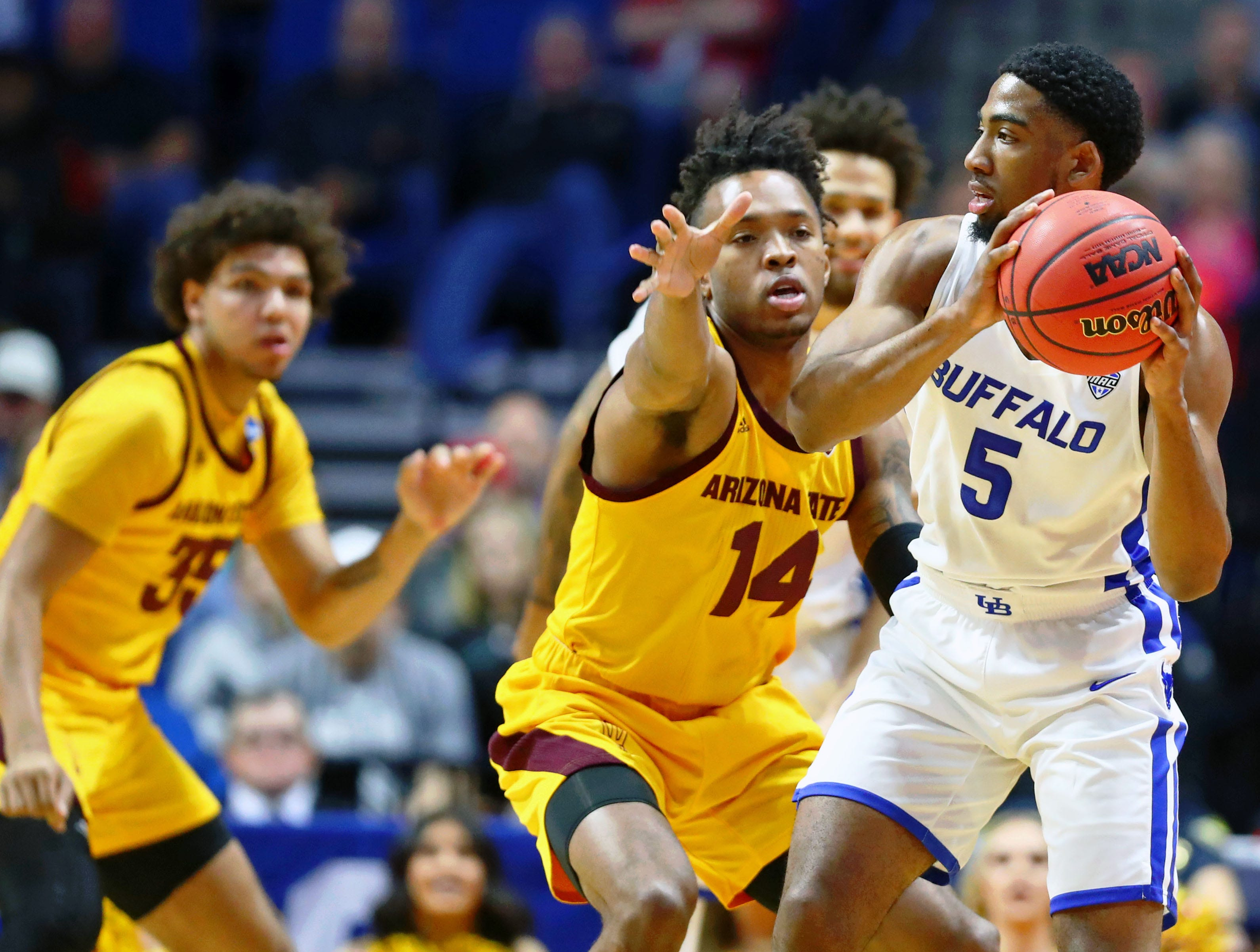 Mar 22, 2019; Tulsa, OK, USA; Buffalo Bulls guard CJ Massinburg (5) holds the ball while defended by Arizona State Sun Devils forward Kimani Lawrence (14) during the first half in the first round of the 2019 NCAA Tournament at BOK Center. Mandatory Credit: Mark J. Rebilas-USA TODAY Sports