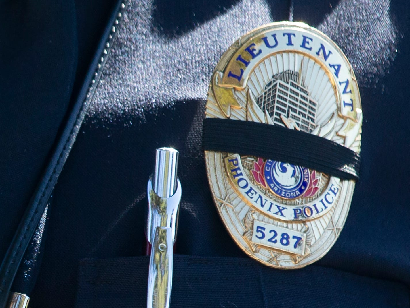 Lt. Barbara Alexander wears a black band on her badge March 22, 2019, honoring Officer Paul Rutherford, who was killed in a crash March 21.