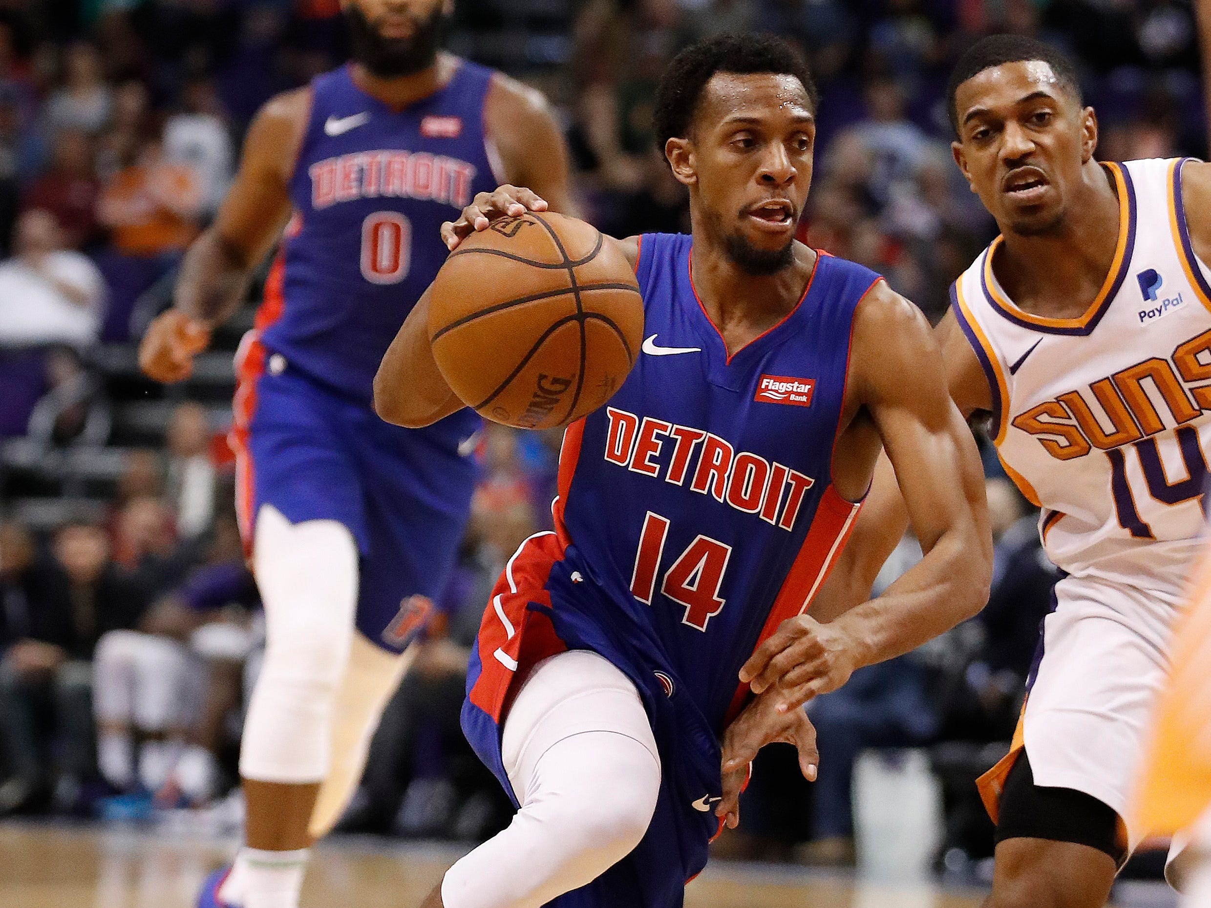 Detroit Pistons guard Ish Smith (14) drives against Phoenix Suns guard De'Anthony Melton (14) during the first half of an NBA basketball game, Thursday, March 21, 2019, in Phoenix.