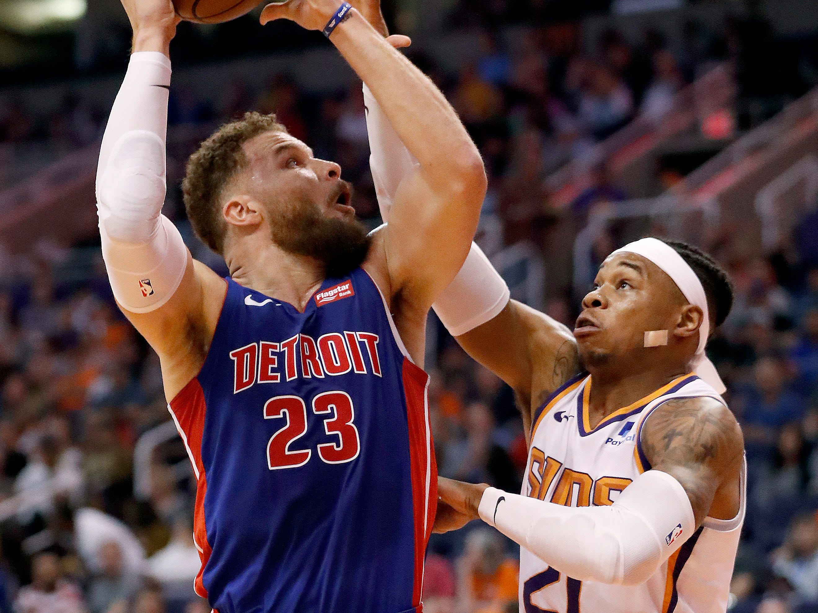 Detroit Pistons forward Blake Griffin (23) shoots over Phoenix Suns forward Richaun Holmes (21) during the first half of an NBA basketball game Thursday, March 21, 2019, in Phoenix.