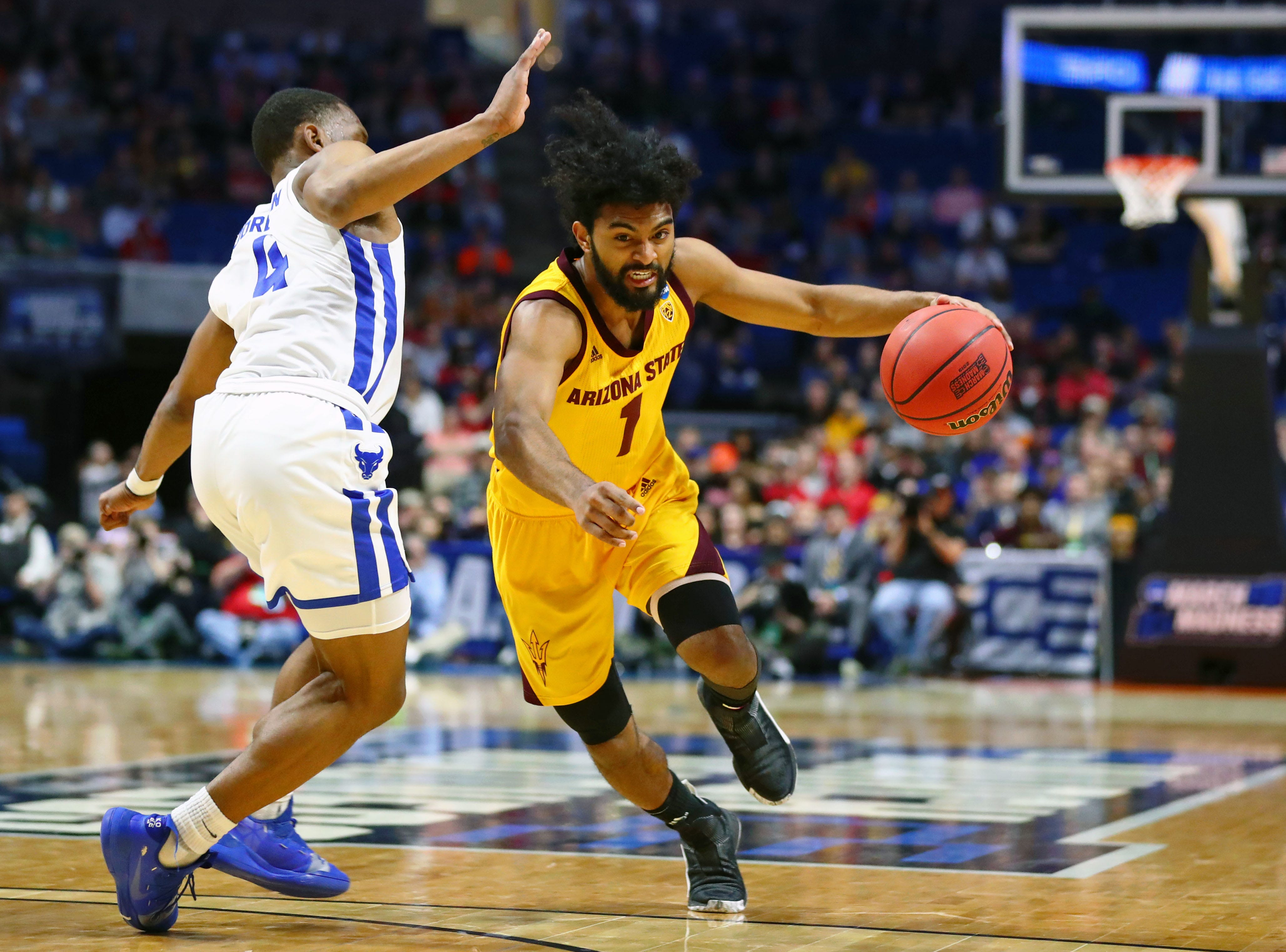 Mar 22, 2019; Tulsa, OK, USA; Arizona State Sun Devils guard Remy Martin (1) dribbles around Buffalo Bulls guard Davonta Jordan (4) during the first half in the first round of the 2019 NCAA Tournament at BOK Center. Mandatory Credit: Mark J. Rebilas-USA TODAY Sports