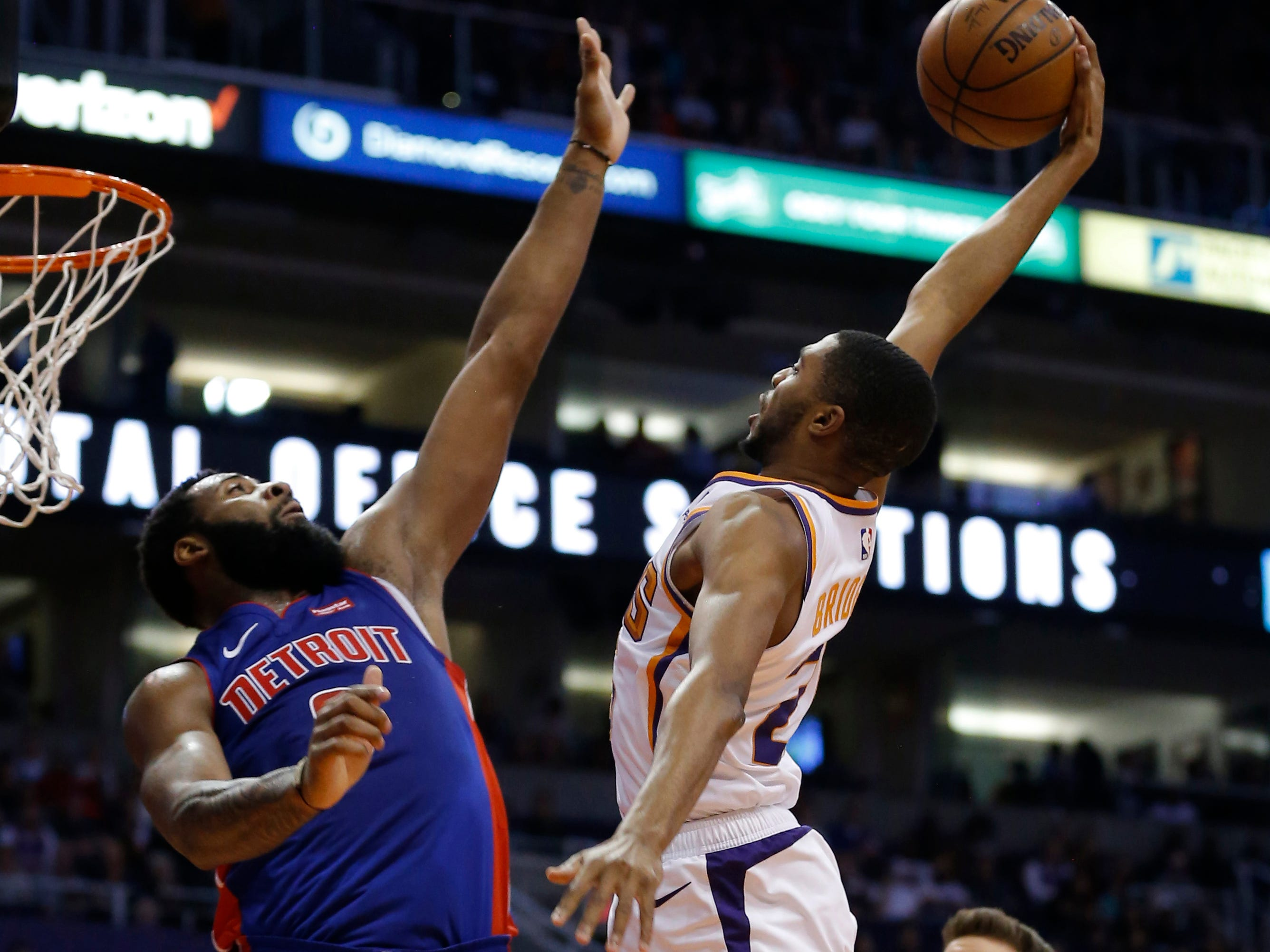 Mar 21, 2019; Phoenix, AZ, USA; Phoenix Suns forward Mikal Bridges (25) shoots over Detroit Pistons center Andre Drummond (0) in the first half during an NBA basketball game at Talking Stick Resort Arena.