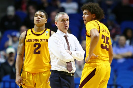 Arizona State coach Bobby Hurley talks with forward Taeshon Cherry during a timeout in an NCAA Tournament game against Buffalo on March 22.