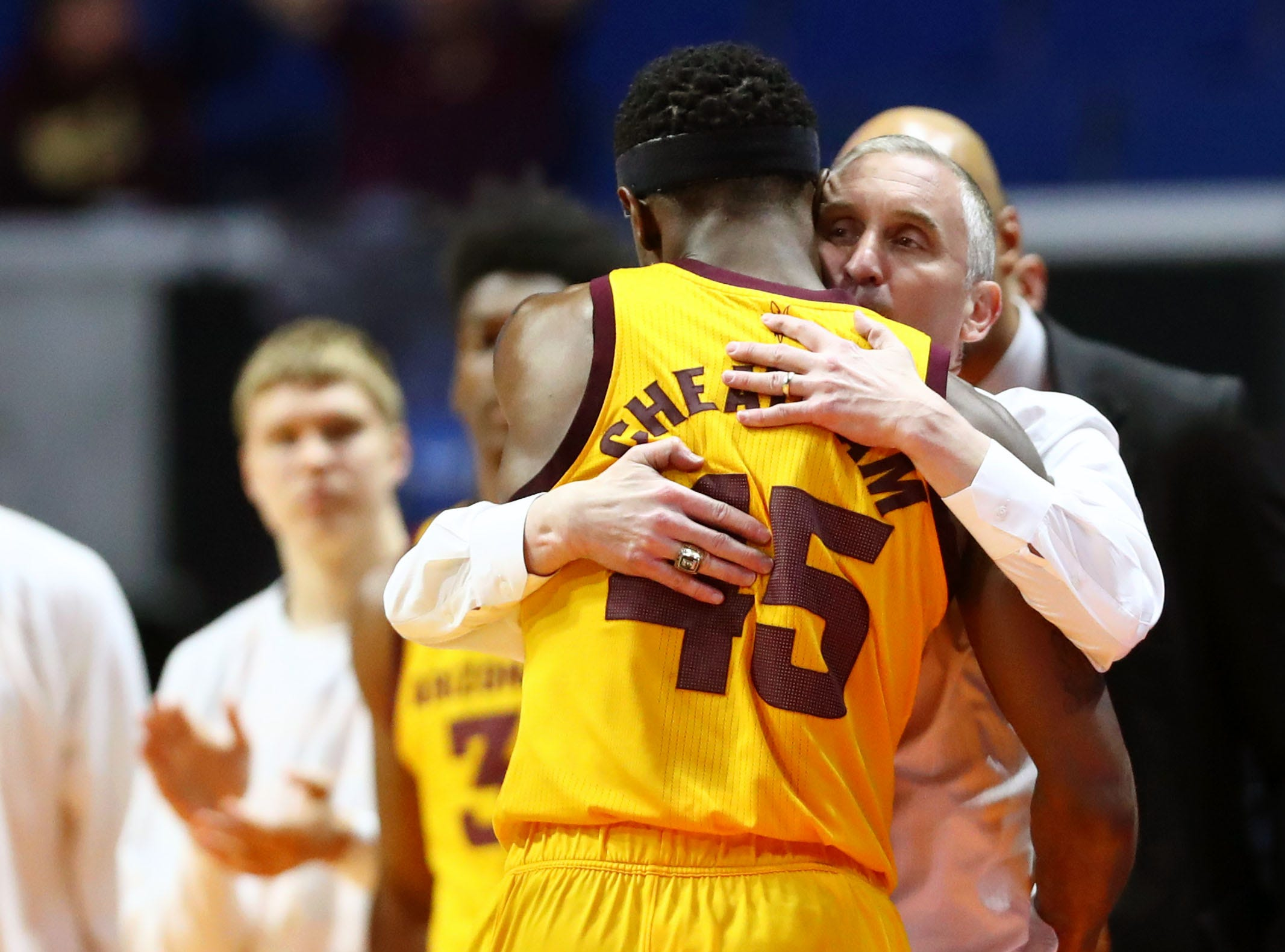 Mar 22, 2019; Tulsa, OK, USA; Arizona State Sun Devils head coach Bobby Hurley hugs forward Zylan Cheatham (45) in the final minutes of the game in their loss to Buffalo Bulls in the first round of the 2019 NCAA Tournament at BOK Center. The Buffalo Bulls won 91-74. Mandatory Credit: Mark J. Rebilas-USA TODAY Sports