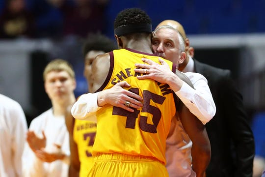 Arizona State coach Bobby Hurley embraces senior forward Zylan Cheatham during the final minutes of the Sun Devils' loss to Buffalo.