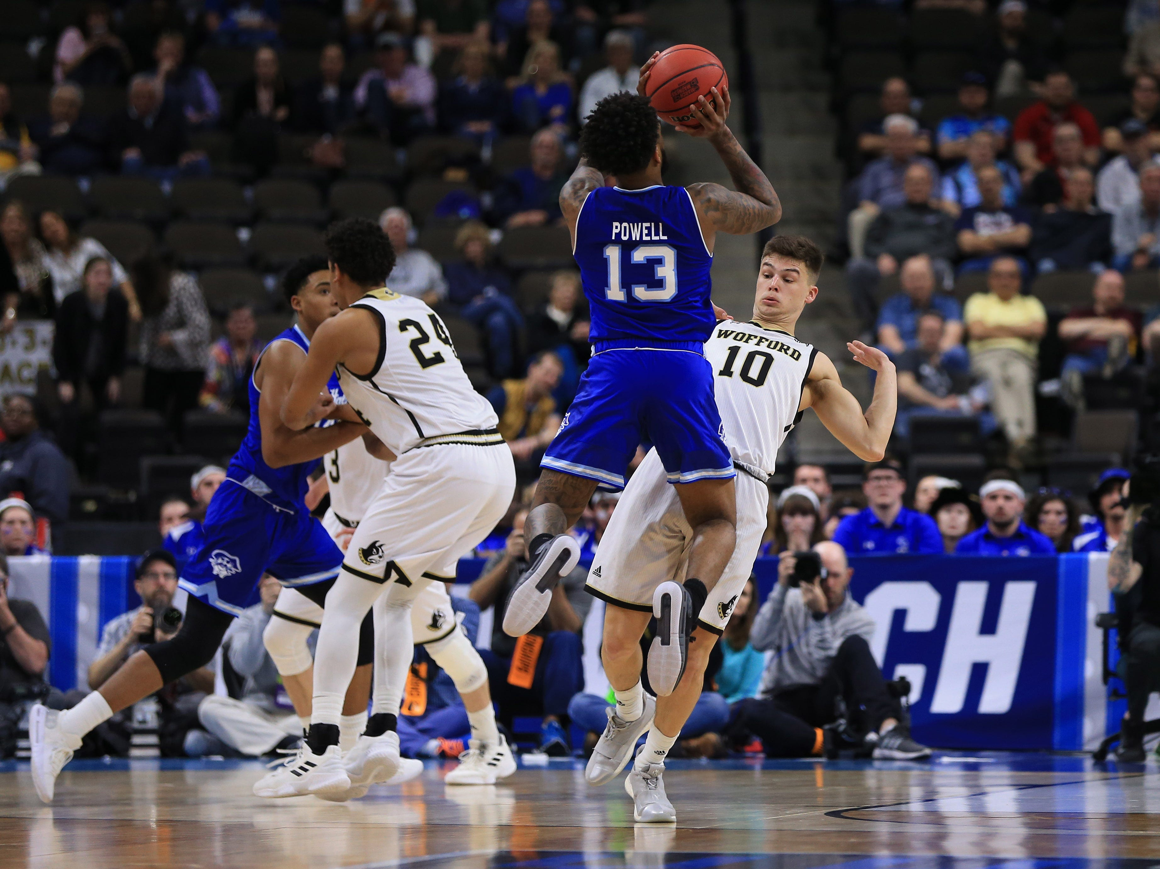 Mar 21, 2019; Jacksonville, FL, USA; Wofford Terriers guard Nathan Hoover (10) defends a shot by Seton Hall Pirates guard Myles Powell (13) during the second half in the first round of the 2019 NCAA Tournament at Jacksonville Veterans Memorial Arena. Mandatory Credit: Matt Stamey-USA TODAY Sports