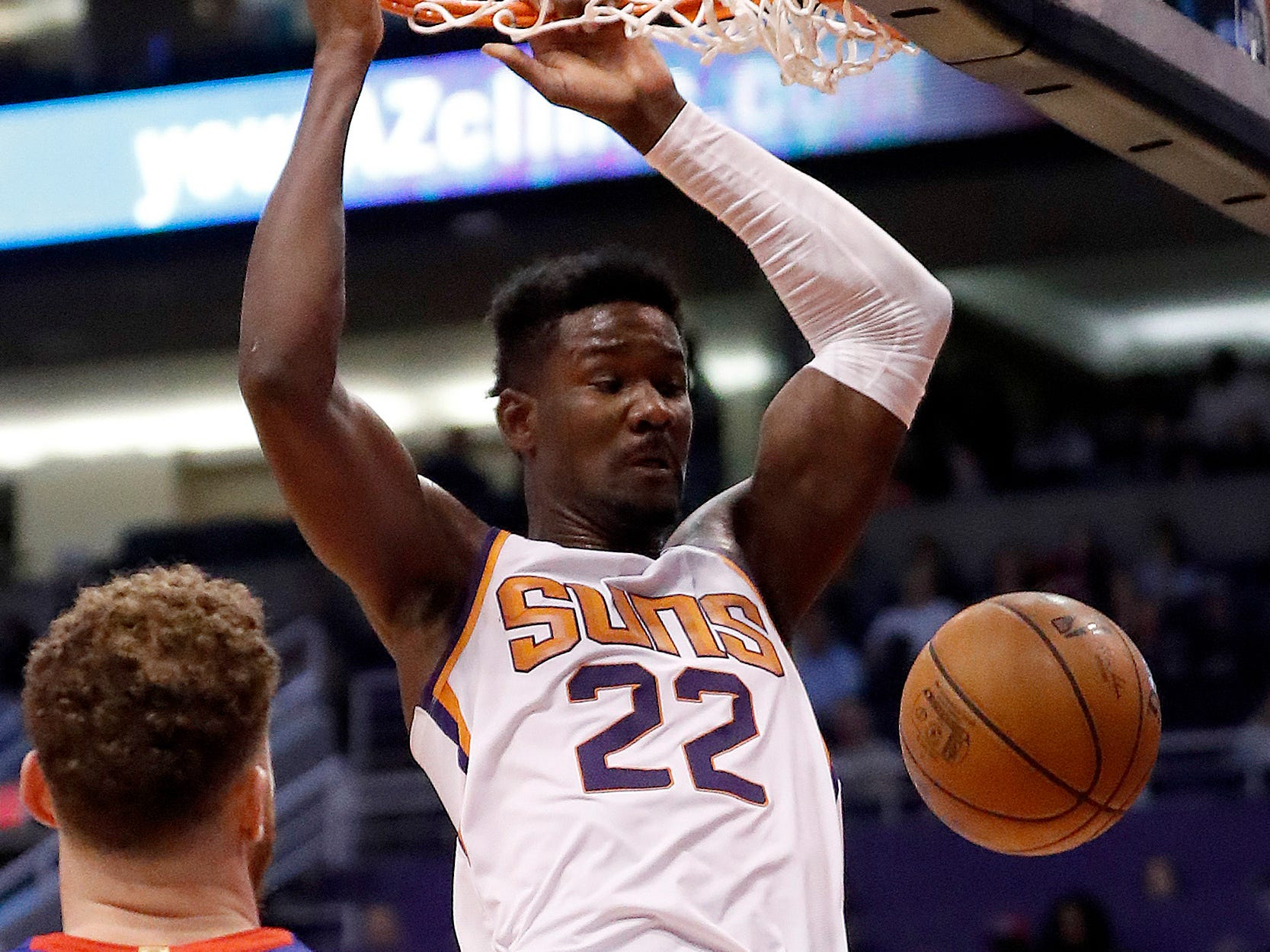 Phoenix Suns center Deandre Ayton (22) dunks as Detroit Pistons forward Blake Griffin (23) watches during the second half of an NBA basketball game Thursday, March 21, 2019, in Phoenix.