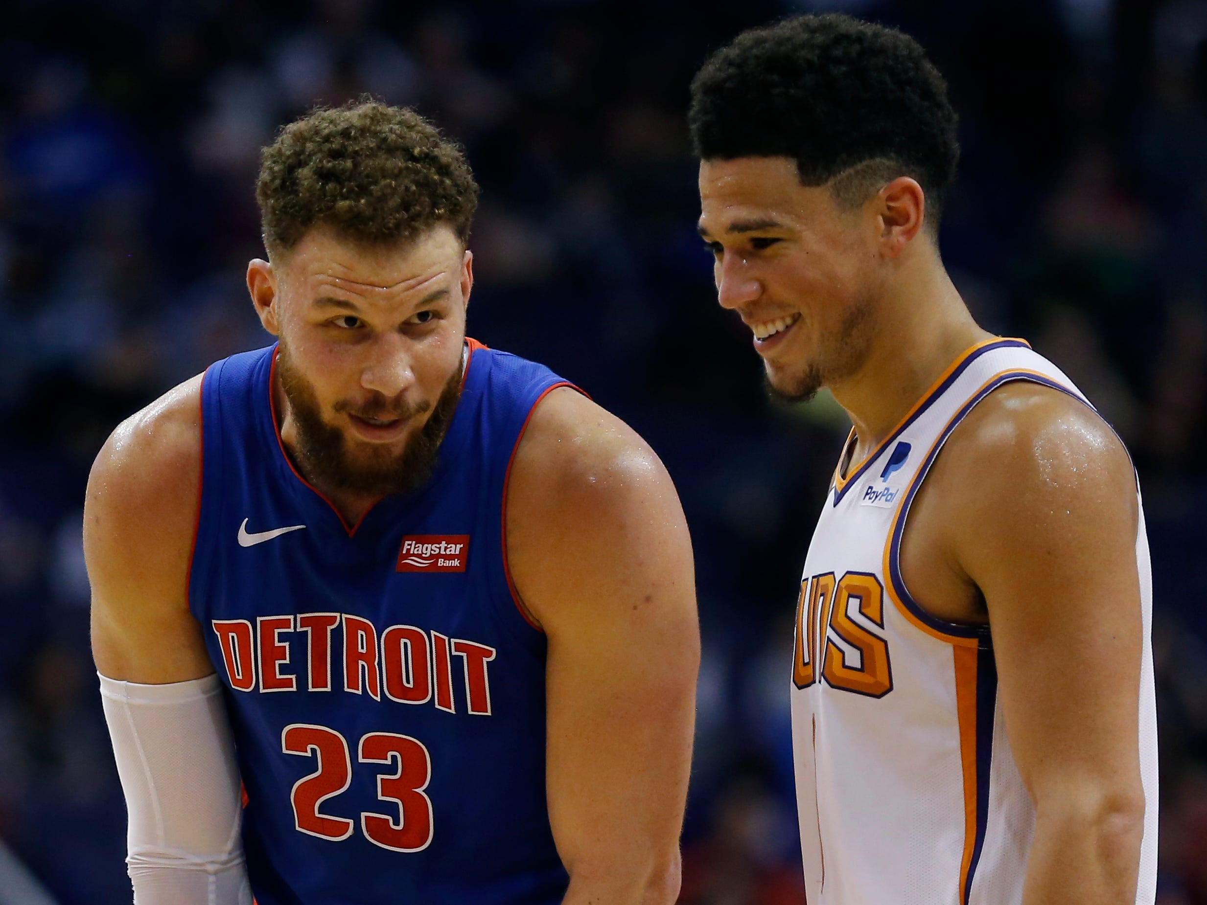 Mar 21, 2019; Phoenix, AZ, USA; Detroit Pistons forward Blake Griffin (23) and Phoenix Suns guard Devin Booker (1) talk in the second half during an NBA basketball game at Talking Stick Resort Arena.