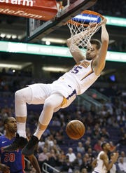 Suns' Dragan Bender (35) dunks against the Pistons during the first half at the Talking Stick Resort Arena in Phoenix, Ariz. on March 21, 2019.