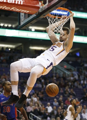 Phoenix's Dragan Bender dunks against Detroit at the Talking Stick Resort Arena in Phoenix on March 21.