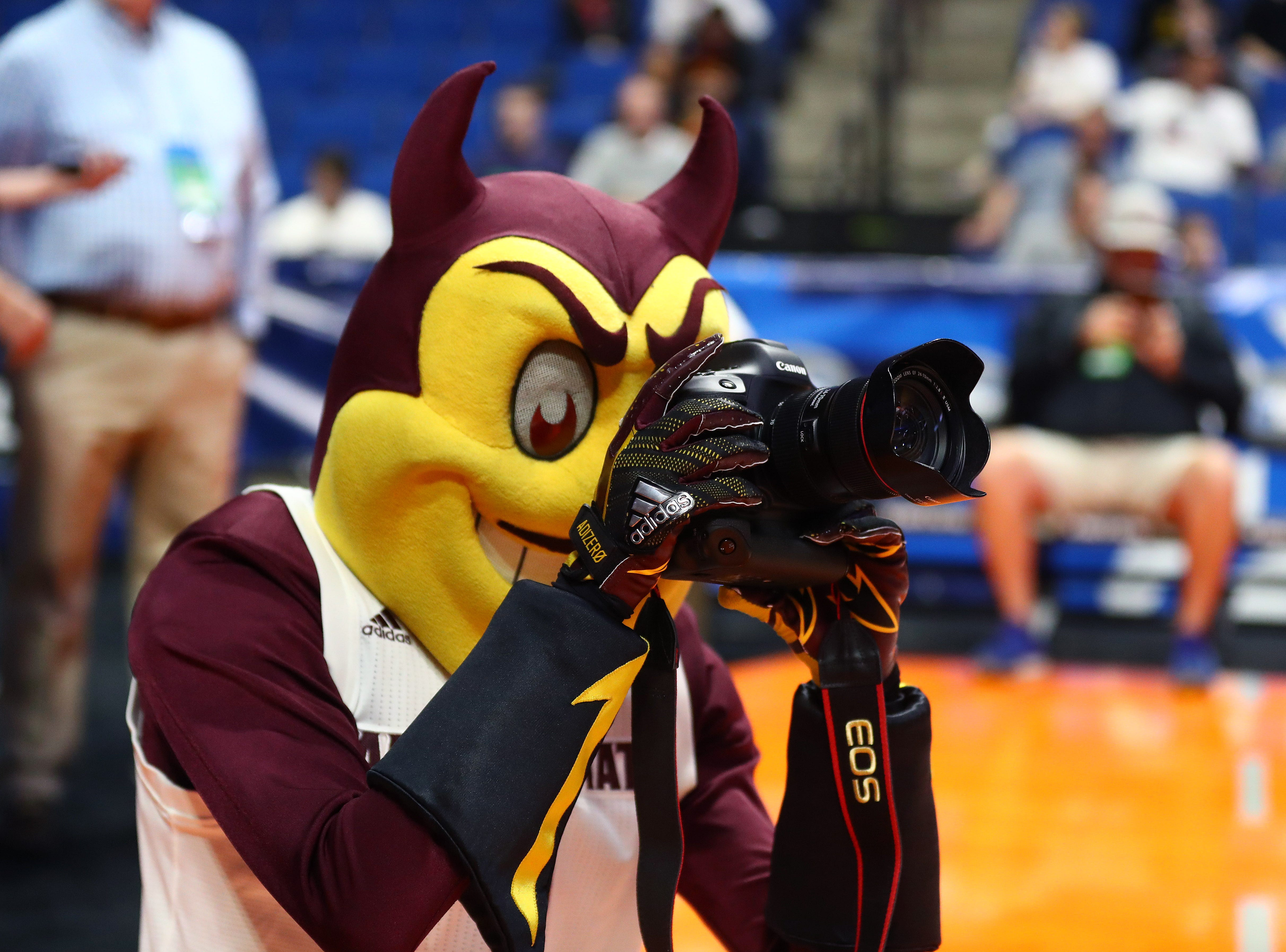 Mar 21, 2019; Tulsa, OK, USA; Arizona State Sun Devils mascot Sparky uses a Canon camera during practice before the first round of the 2019 NCAA Tournament at BOK Center. Mandatory Credit: Mark J. Rebilas-USA TODAY Sports