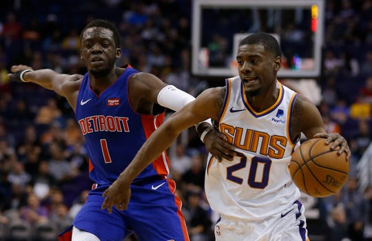 Mar 21, 2019; Phoenix, AZ, USA; Phoenix Suns forward Josh Jackson (20) drives past Detroit Pistons guard Reggie Jackson (1) in the first half during an NBA basketball game at Talking Stick Resort Arena.