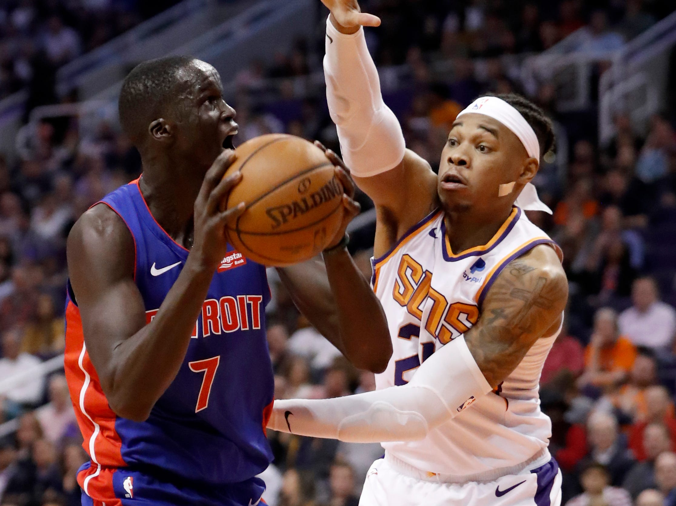 Detroit Pistons forward Thon Maker (7) prepares to shoot as Phoenix Suns forward Richaun Holmes defends during the first half of an NBA basketball game Thursday, March 21, 2019, in Phoenix.