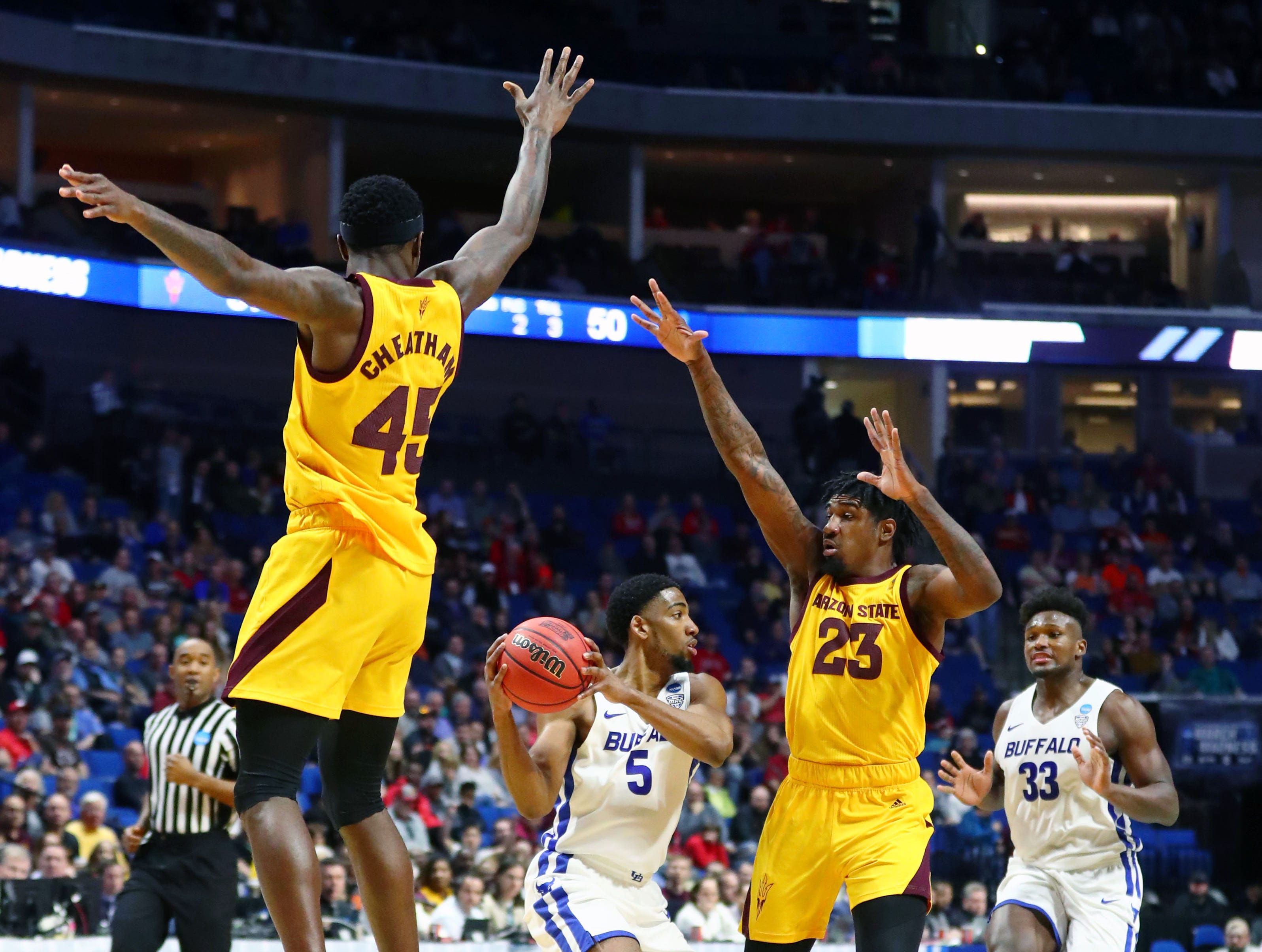 Mar 22, 2019; Tulsa, OK, USA; Buffalo Bulls guard CJ Massinburg (5) holds the ball while under pressure by Arizona State Sun Devils forward Zylan Cheatham (45) and forward Romello White (23) during the second half in the first round of the 2019 NCAA Tournament at BOK Center. Mandatory Credit: Mark J. Rebilas-USA TODAY Sports