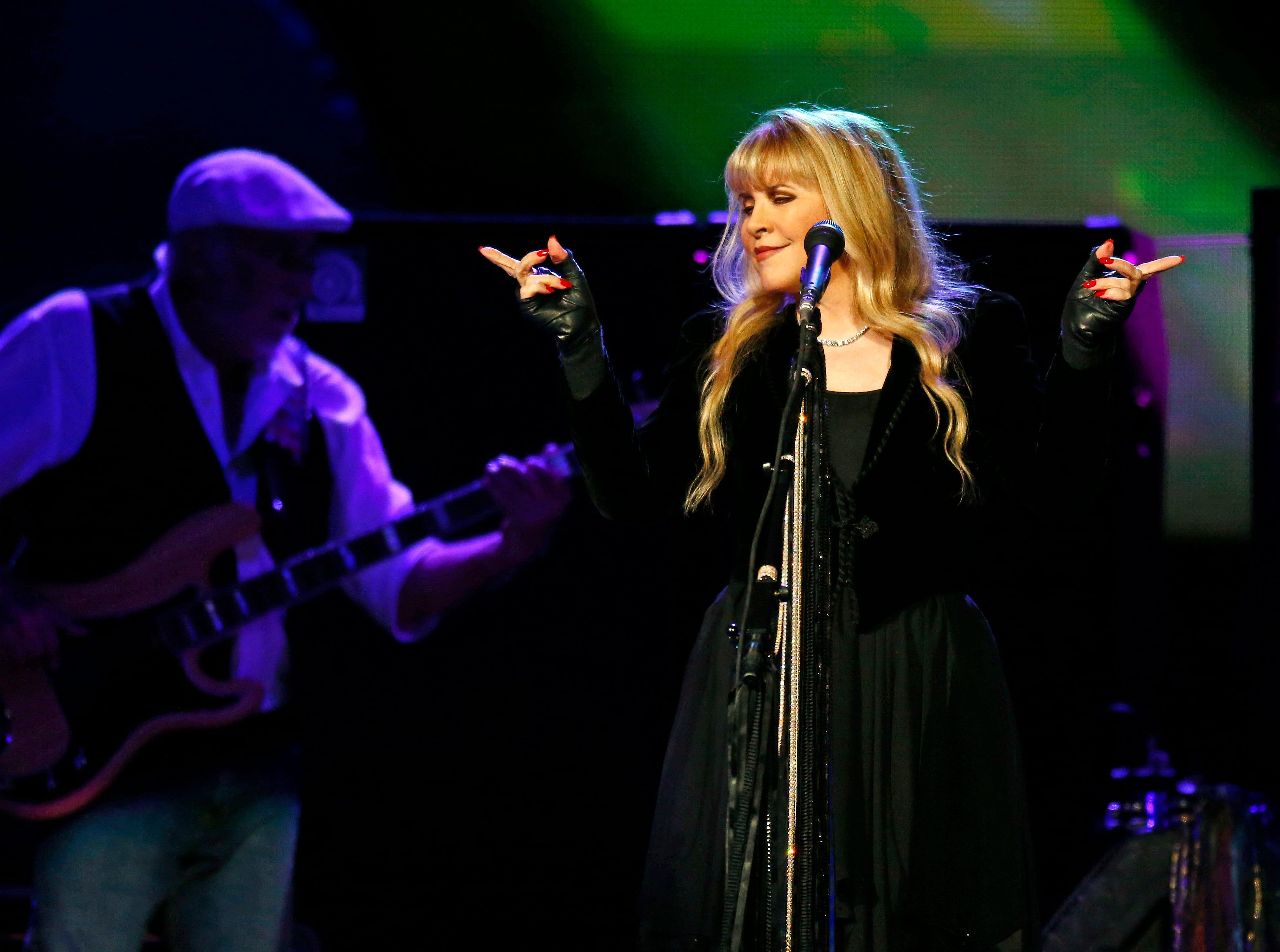 Fleetwood Mac's Stevie Nicks and bassist John McVie perform May 30, 2013, at U.S. Airways Center in Phoenix.
