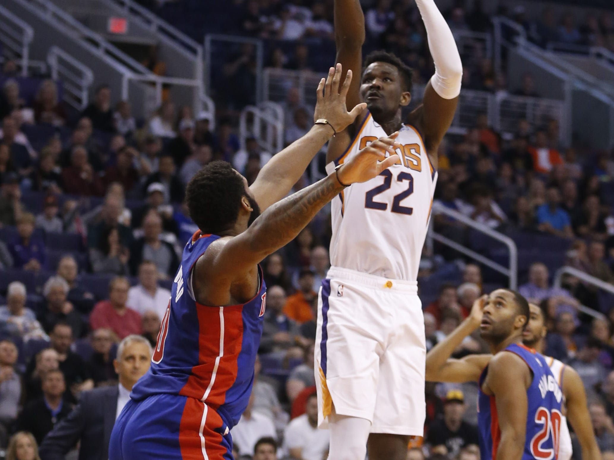 Suns' Deandre Ayton (22) shoots against Pistons' Andre Drummond (0) during the first half at the Talking Stick Resort Arena in Phoenix, Ariz. on March 21, 2019.