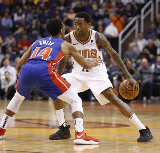 Suns' Jamal Crawford (11) dribbles against Pistons' Ish Smith (14) during the first half at the Talking Stick Resort Arena in Phoenix, Ariz. on March 21, 2019.