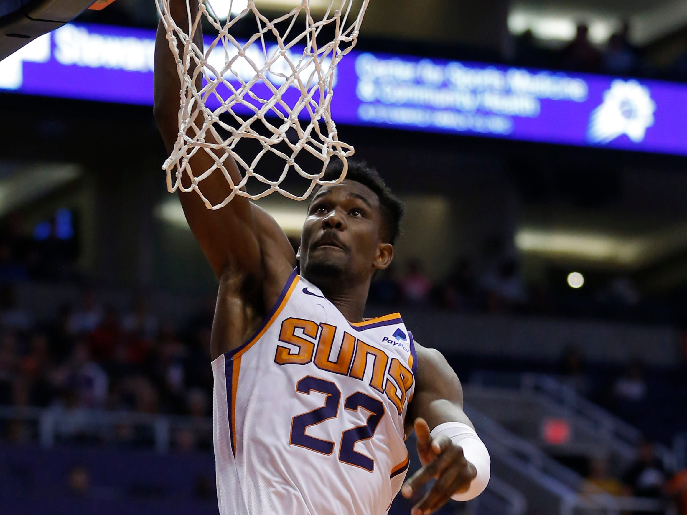 Mar 21, 2019; Phoenix, AZ, USA; Phoenix Suns center Deandre Ayton (22) scores against the Detroit Pistons in the first half during an NBA basketball game at Talking Stick Resort Arena.