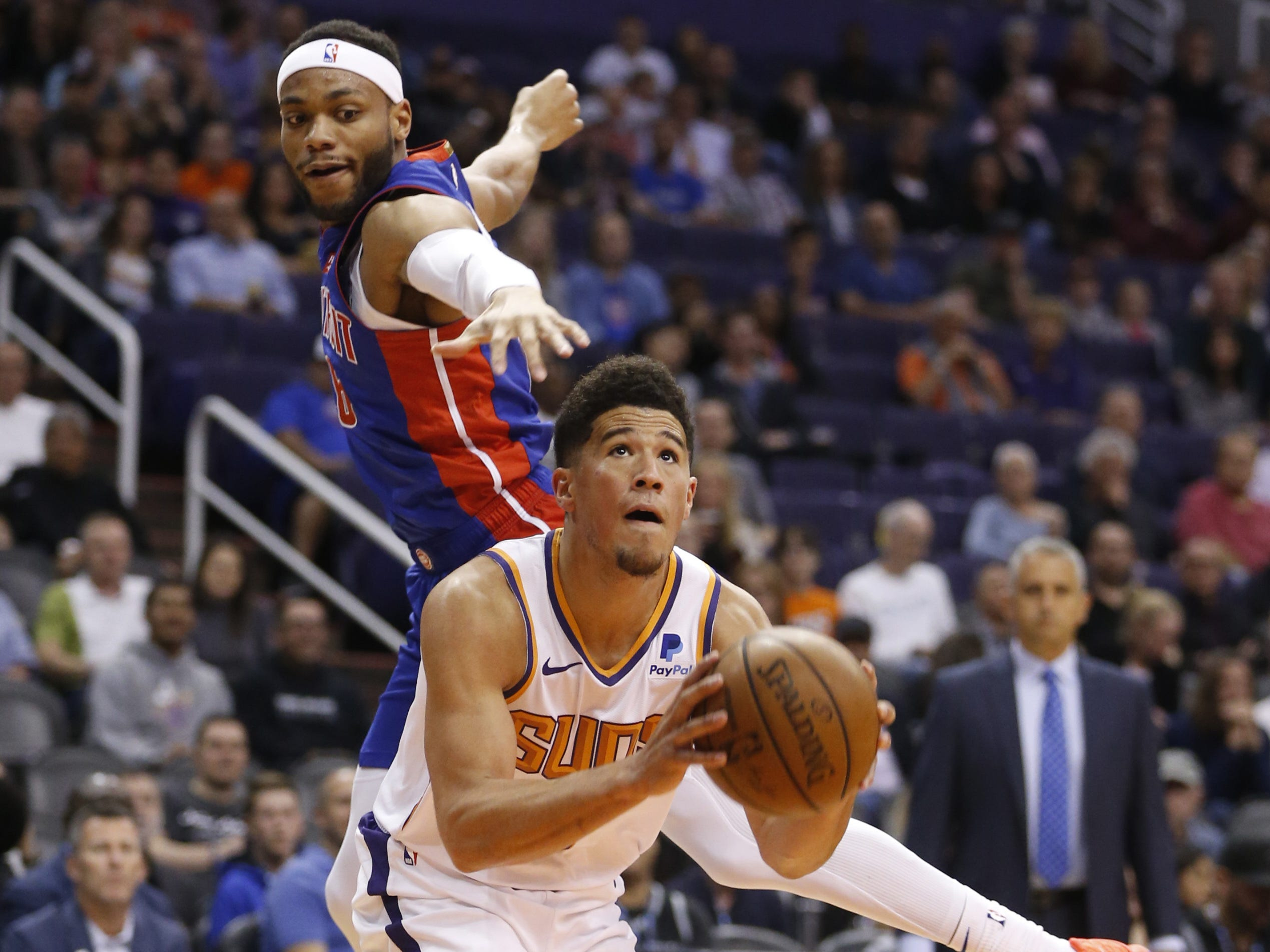 Suns' Devin Booker (1) shoots against Pistons' Bruce Brown (6) during the first half at the Talking Stick Resort Arena in Phoenix, Ariz. on March 21, 2019.