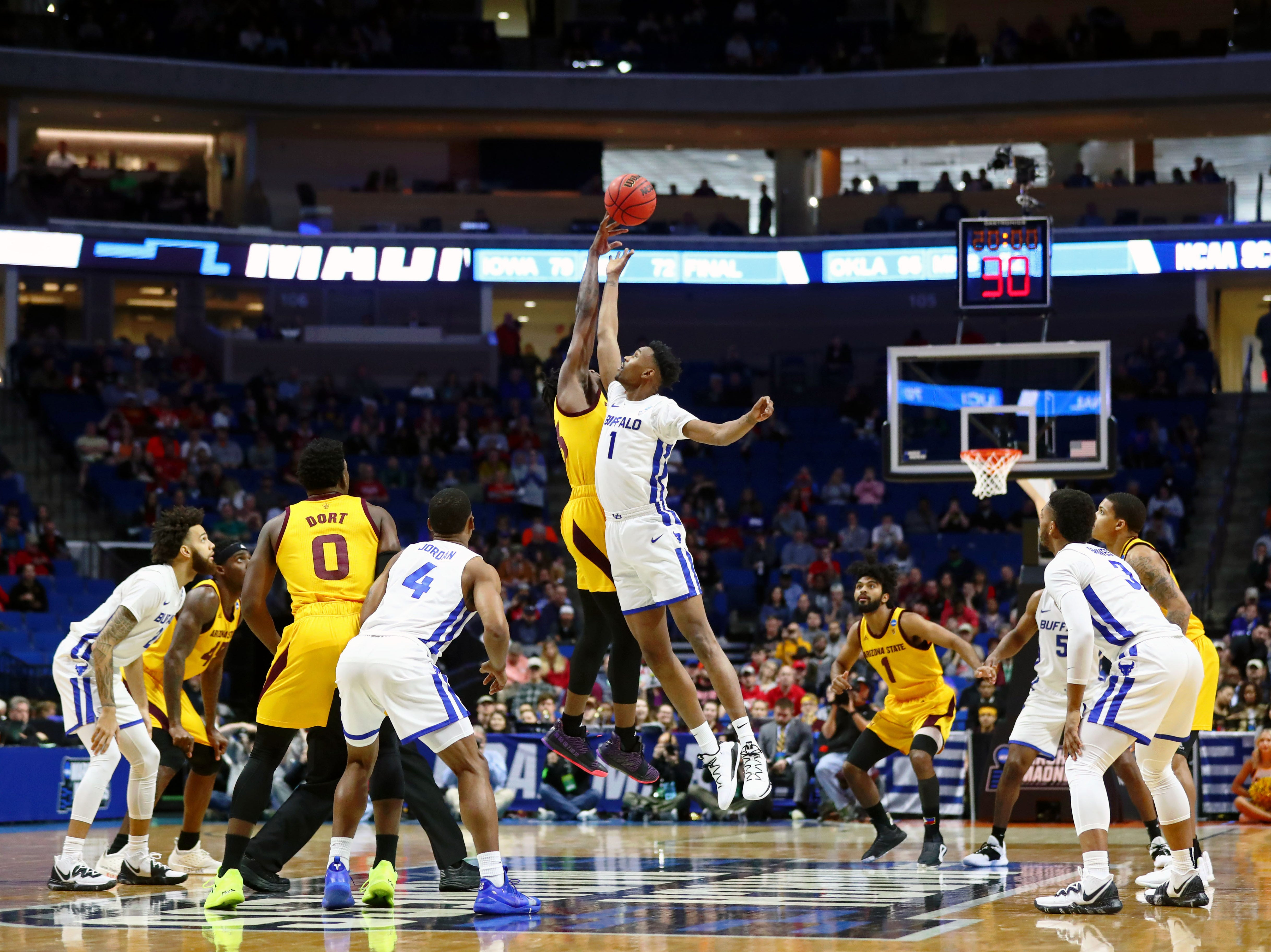 Mar 22, 2019; Tulsa, OK, USA; The tipoff at the start of the game between the Arizona State Sun Devils and the Buffalo Bulls in the first round of the 2019 NCAA Tournament at BOK Center. Mandatory Credit: Mark J. Rebilas-USA TODAY Sports