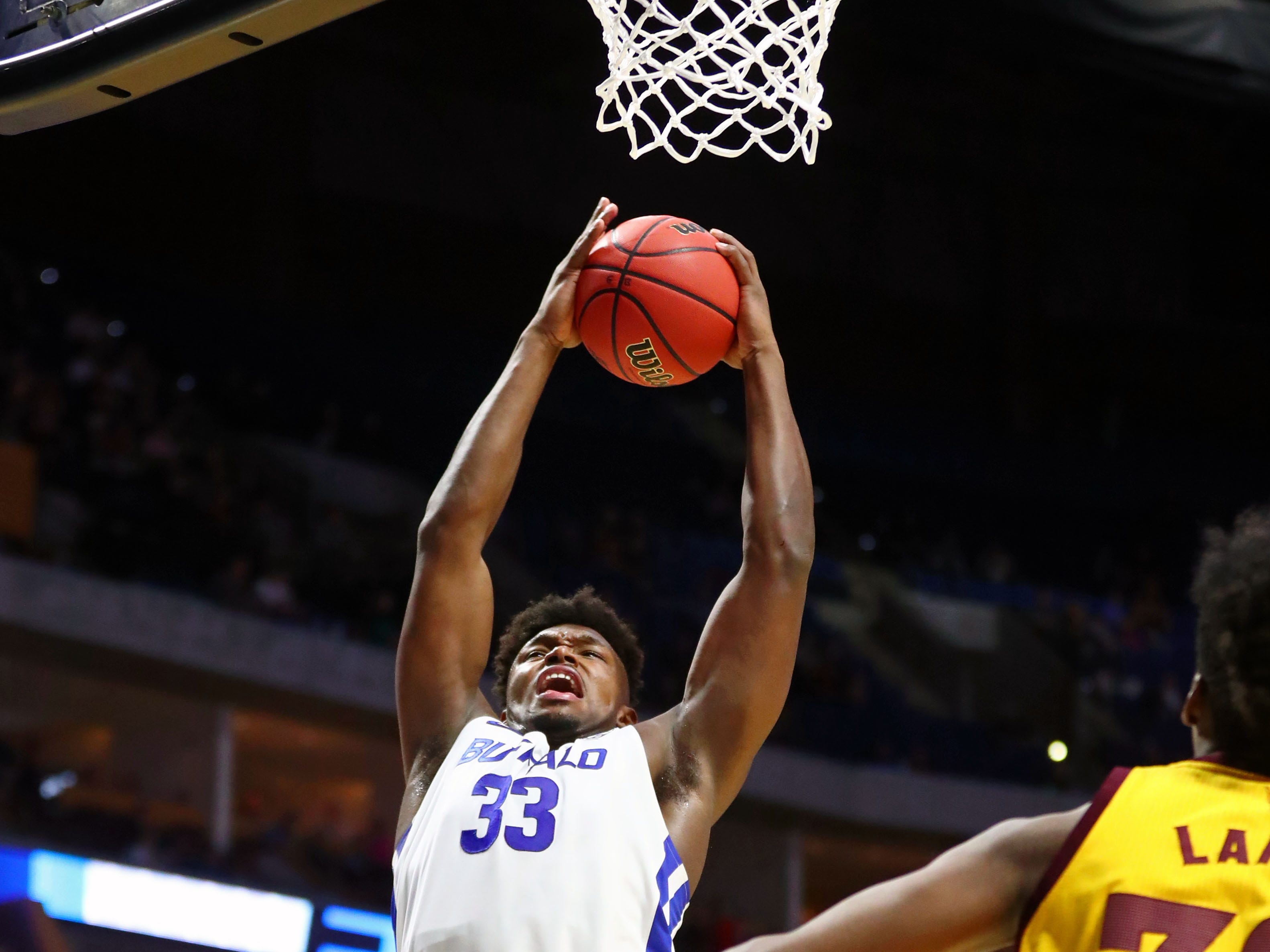Mar 22, 2019; Tulsa, OK, USA; Buffalo Bulls forward Nick Perkins (33) grabs a rebound against the Arizona State Sun Devils during the first half in the first round of the 2019 NCAA Tournament at BOK Center. Mandatory Credit: Mark J. Rebilas-USA TODAY Sports