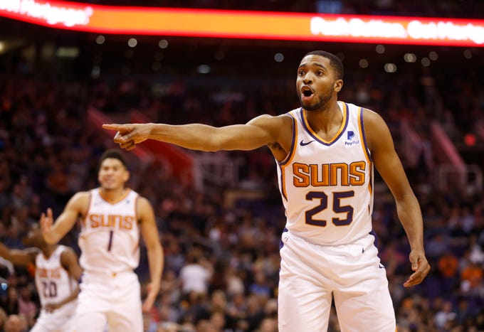Suns forward Mikal Bridges (25) argues with an official during the second half of a game against the Pistons at Talking Stick Resort Arena.