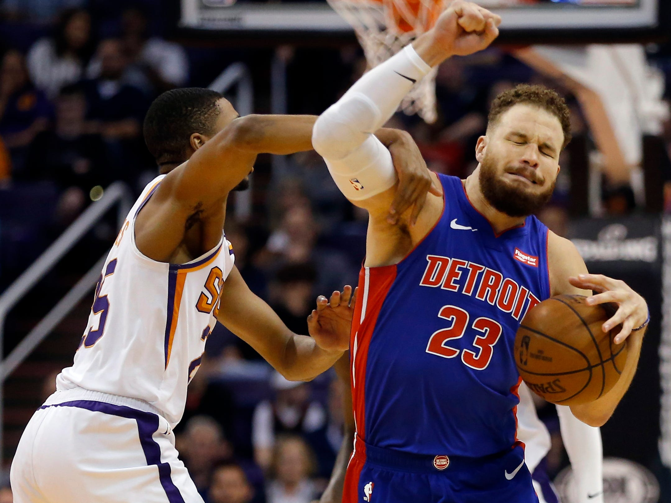 Mar 21, 2019; Phoenix, AZ, USA; Detroit Pistons forward Blake Griffin (23) gets fouled by Phoenix Suns forward Mikal Bridges (25) in the second half during an NBA basketball game at Talking Stick Resort Arena.
