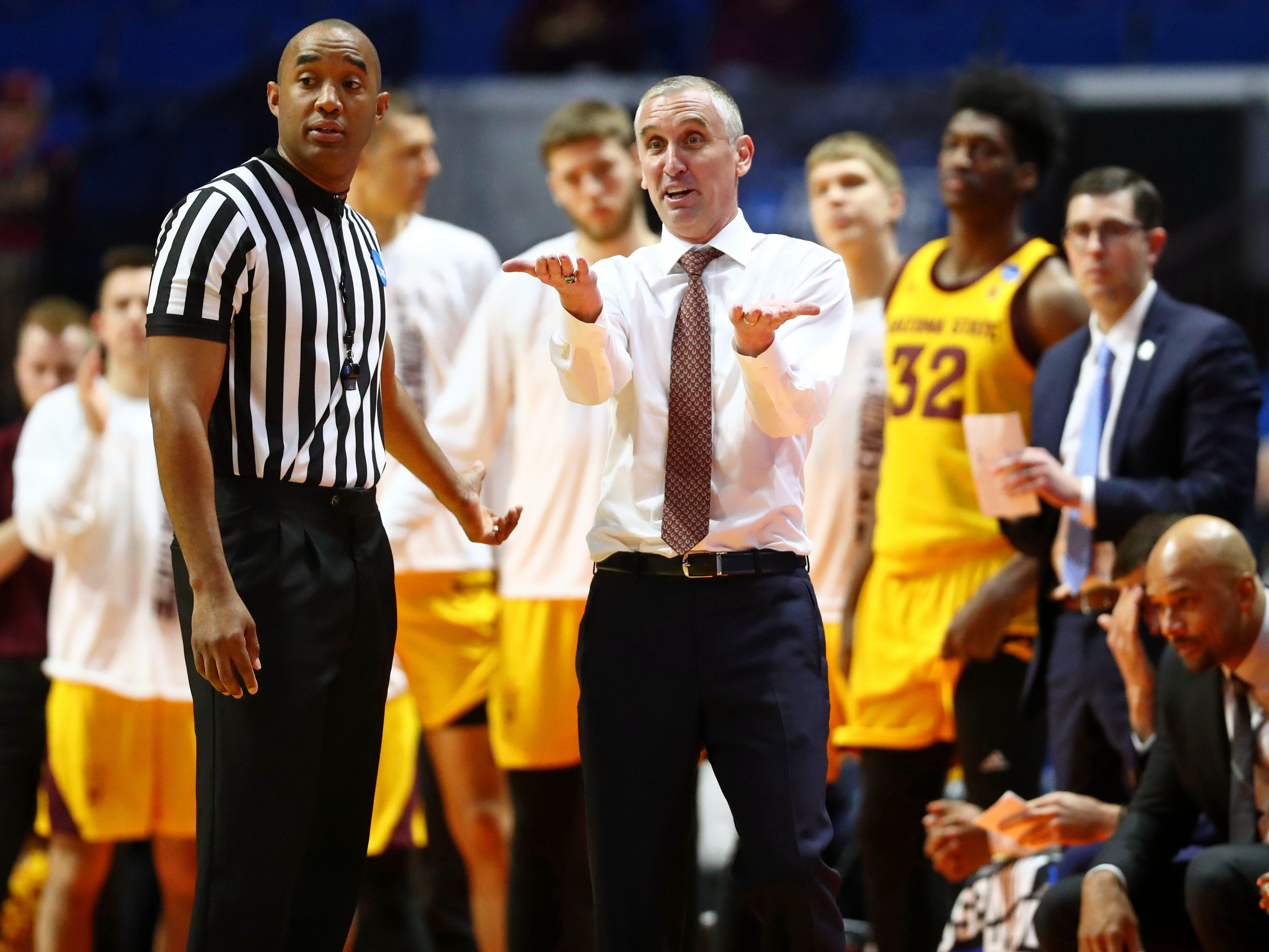 Mar 22, 2019; Tulsa, OK, USA; Arizona State Sun Devils head coach Bobby Hurley talks with an official about a call during the second half of their game against the Buffalo Bulls in the first round of the 2019 NCAA Tournament at BOK Center. The Buffalo Bulls won 91-74. Mandatory Credit: Mark J. Rebilas-USA TODAY Sports