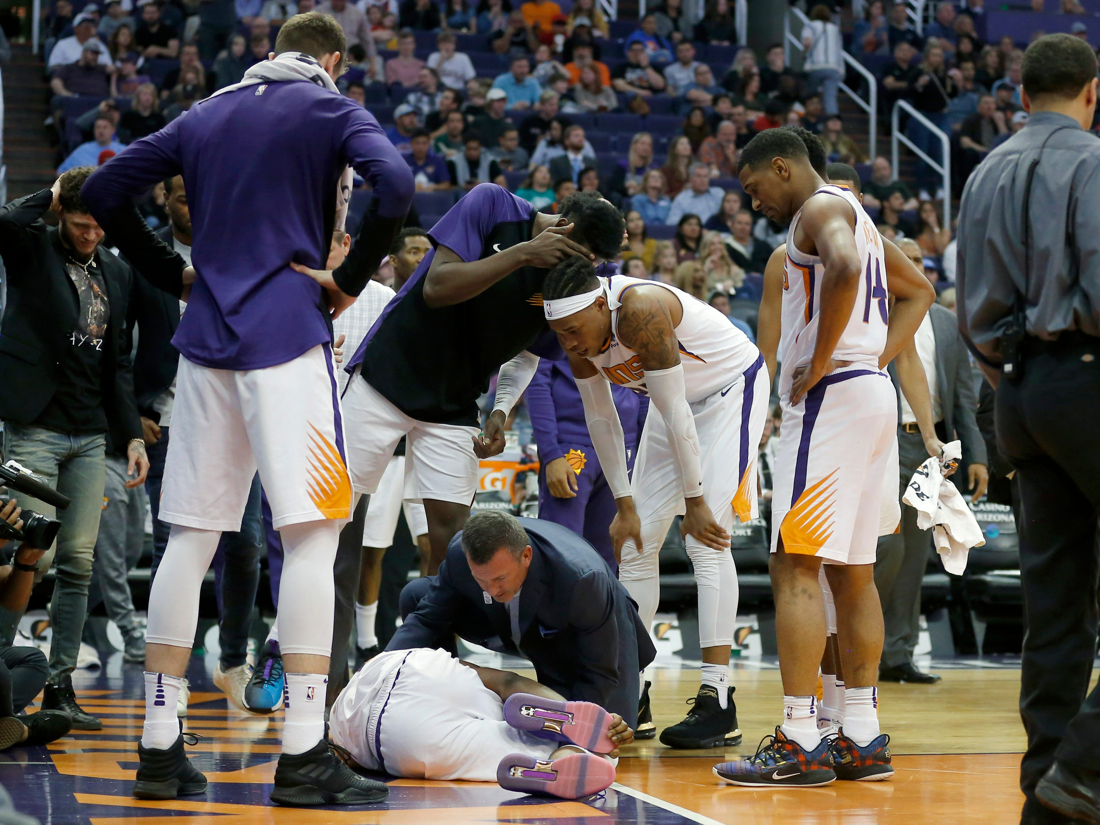 Mar 21, 2019; Phoenix, AZ, USA; Phoenix Suns forward Josh Jackson (20) gets medical help after hitting the floor in the second half during an NBA basketball game against the Detroit Pistons at Talking Stick Resort Arena.