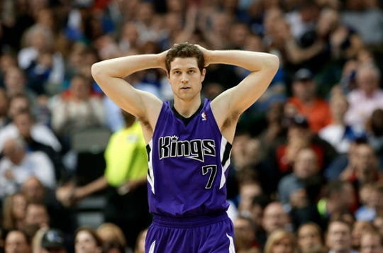 Sacramento Kings point guard Jimmer Fredette (7) looks up court after being charged with a foul against the Dallas Mavericks in the first half of an NBA basketball game, Friday, Jan. 31, 2014, in Dallas. (AP Photo/Tony Gutierrez)