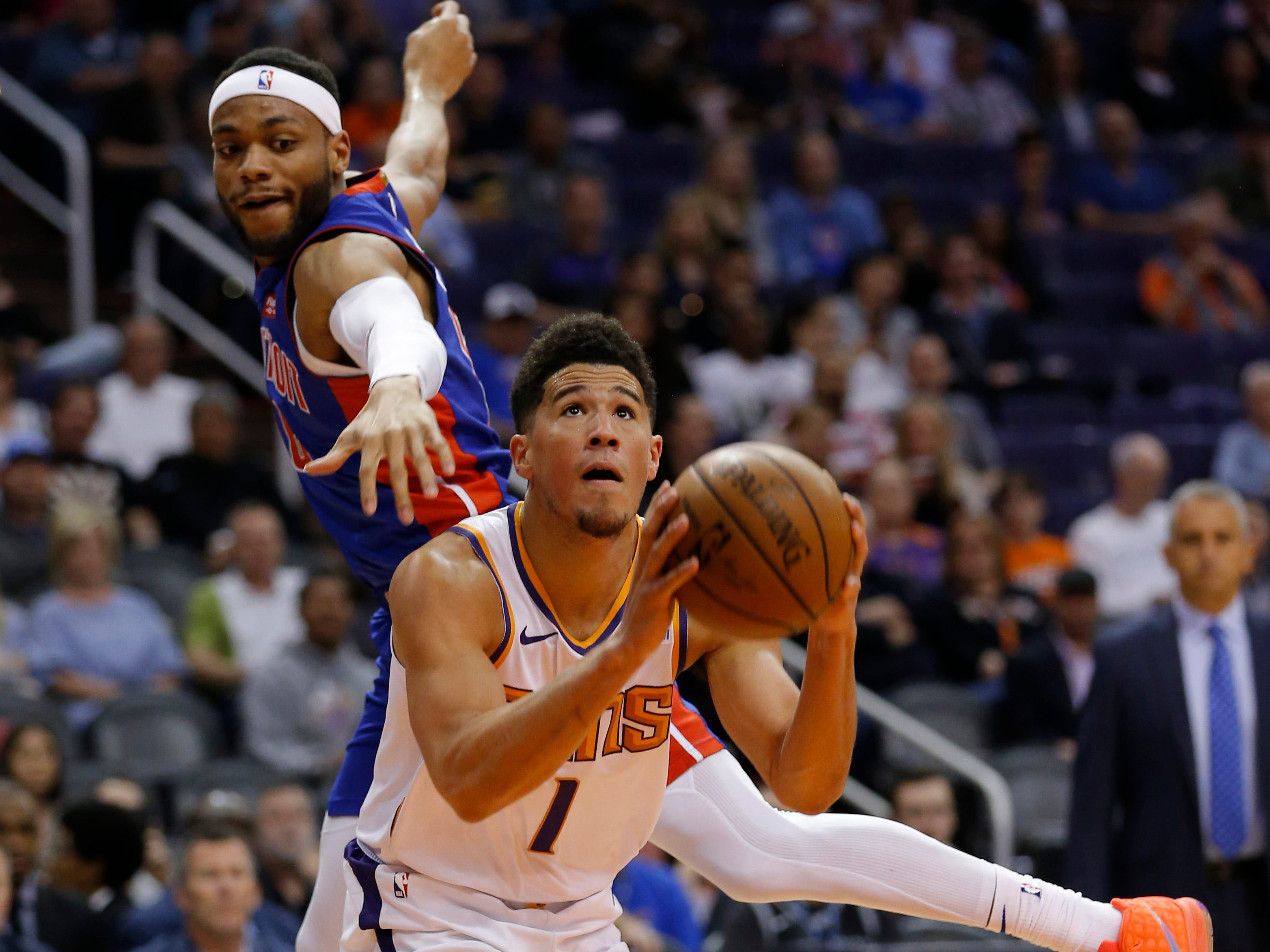 Mar 21, 2019; Phoenix, AZ, USA; Phoenix Suns guard Devin Booker (1) gets pressured by Detroit Pistons guard Bruce Brown (6) in the first half during an NBA basketball game at Talking Stick Resort Arena.