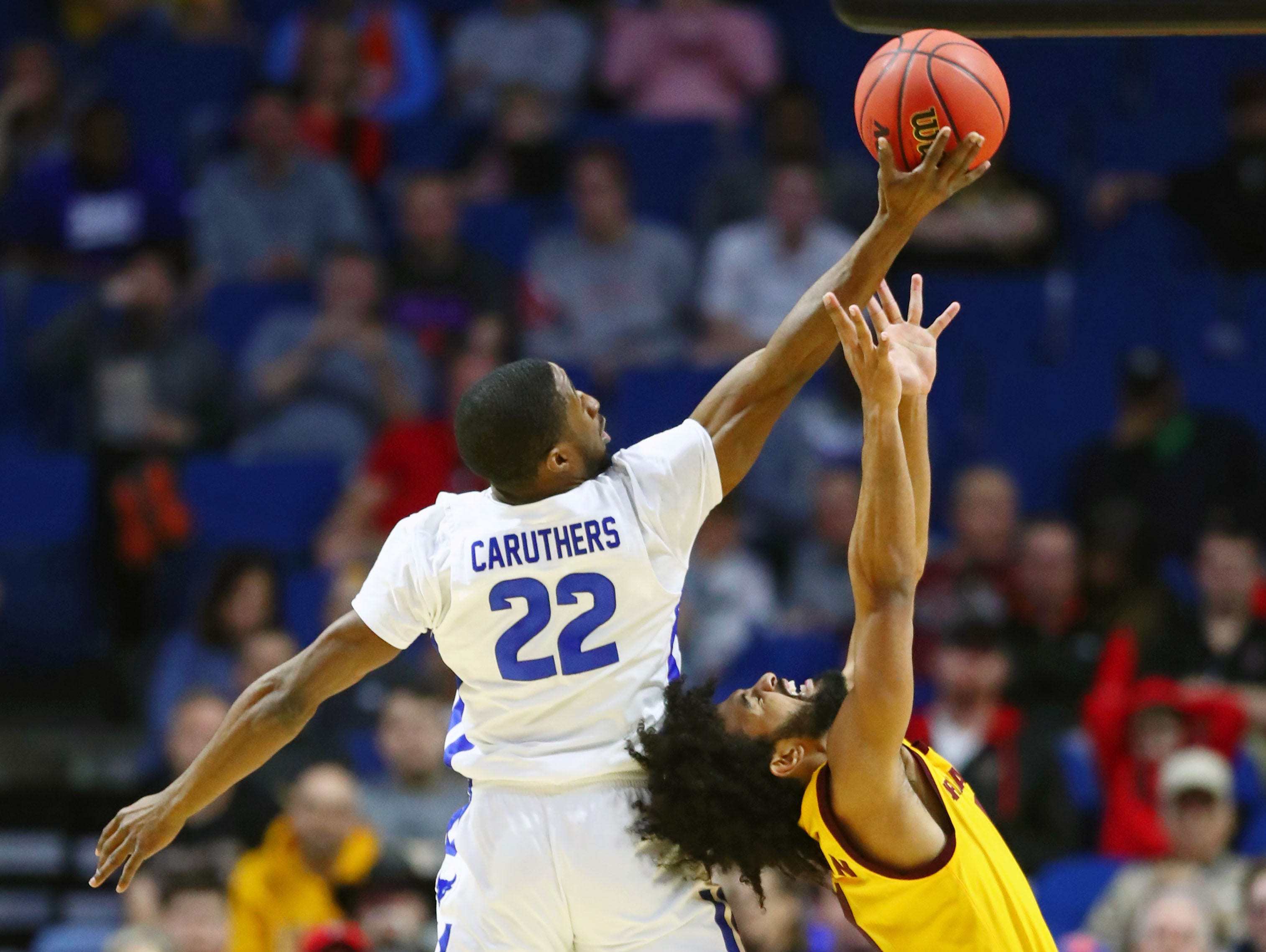Mar 22, 2019; Tulsa, OK, USA; Buffalo Bulls guard Dontay Caruthers (22) reaches for the ball above Arizona State Sun Devils guard Remy Martin (1) during the first half in the first round of the 2019 NCAA Tournament at BOK Center. Mandatory Credit: Mark J. Rebilas-USA TODAY Sports