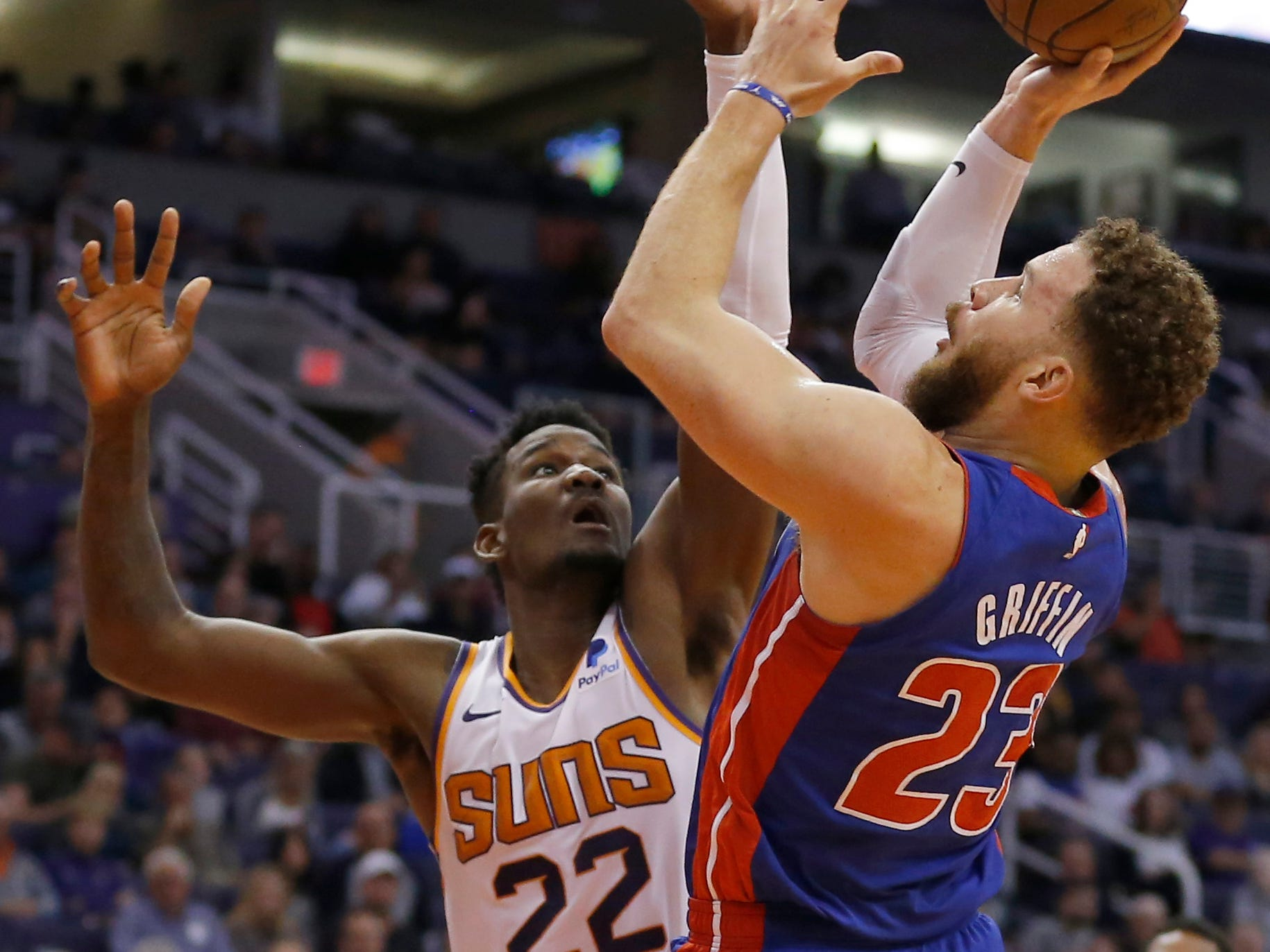 Mar 21, 2019; Phoenix, AZ, USA; Detroit Pistons forward Blake Griffin (23) gets fouled by Phoenix Suns center Deandre Ayton (22) in the second half during an NBA basketball game at Talking Stick Resort Arena.