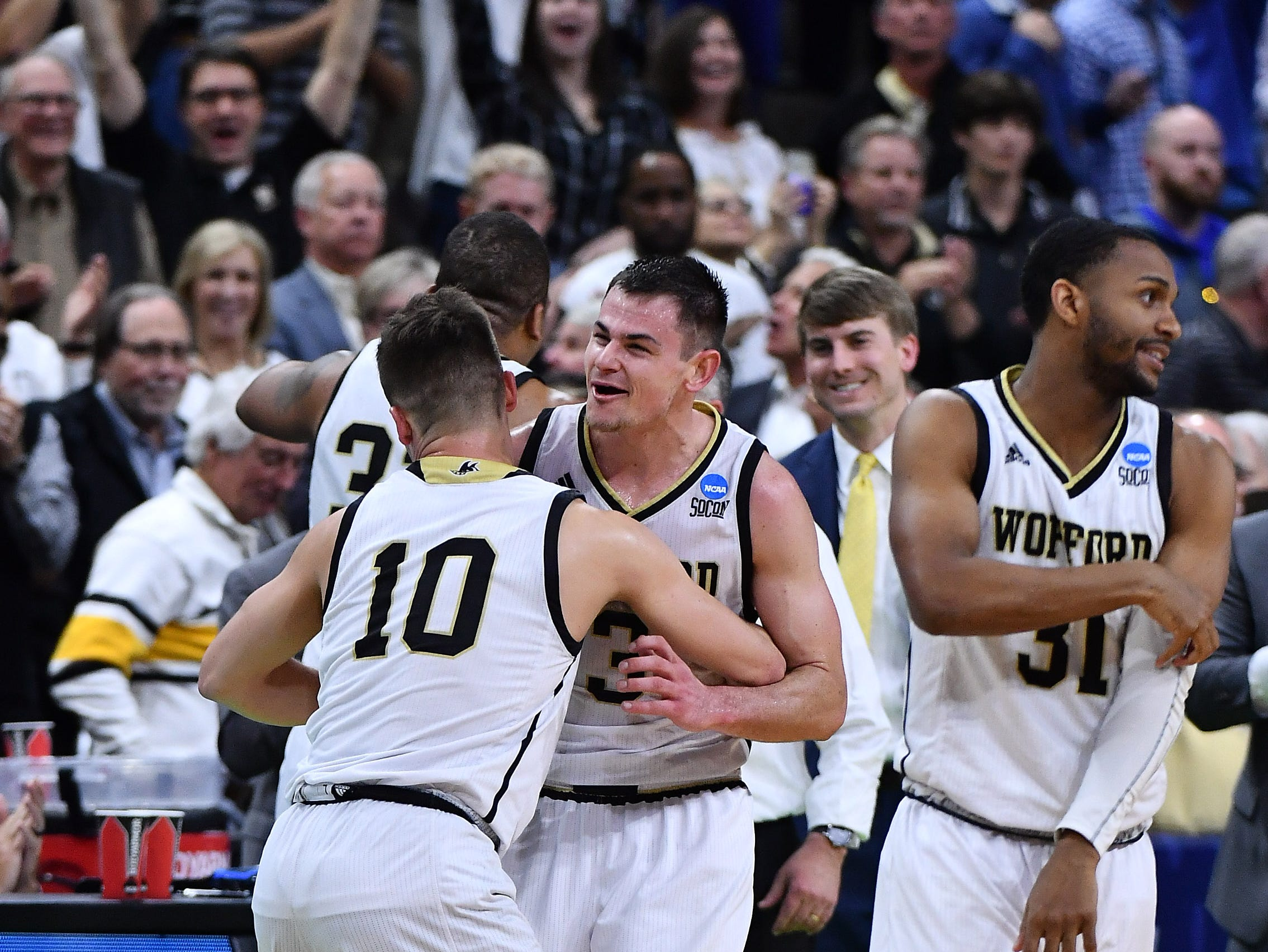 Mar 21, 2019; Jacksonville, FL, USA; Wofford Terriers guard Fletcher Magee (3) celebrates with teammates after defeating the Seton Hall Pirates in the first round of the 2019 NCAA Tournament at Jacksonville Veterans Memorial Arena. Mandatory Credit: John David Mercer-USA TODAY Sports