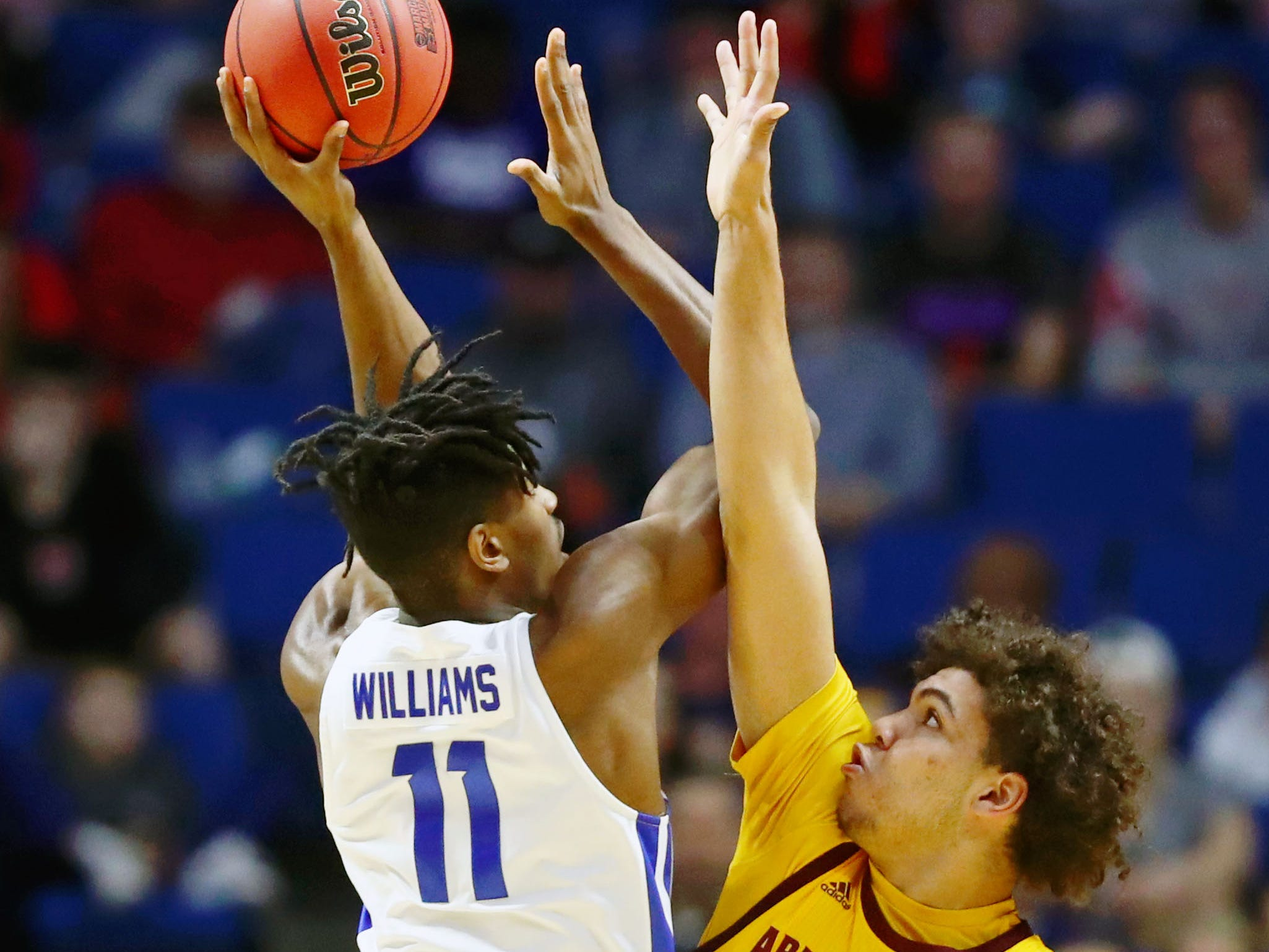 Mar 22, 2019; Tulsa, OK, USA; Arizona State Sun Devils forward Taeshon Cherry (35) attempts to block a shot by Buffalo Bulls forward Jeenathan Williams (11) during the first half in the first round of the 2019 NCAA Tournament at BOK Center. Mandatory Credit: Mark J. Rebilas-USA TODAY Sports