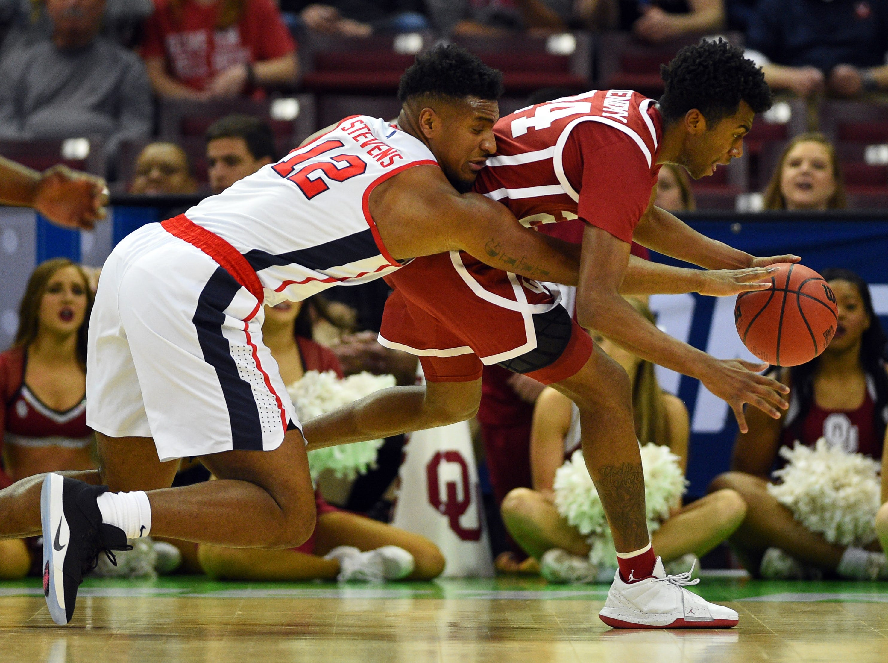 Mar 22, 2019; Columbia, SC, USA; Mississippi Rebels forward Bruce Stevens (12) and Oklahoma Sooners guard Jamal Bieniemy (24) battle for a loose ball during the first half in the first round of the 2019 NCAA Tournament at Colonial Life Arena. Mandatory Credit: Bob Donnan-USA TODAY Sports