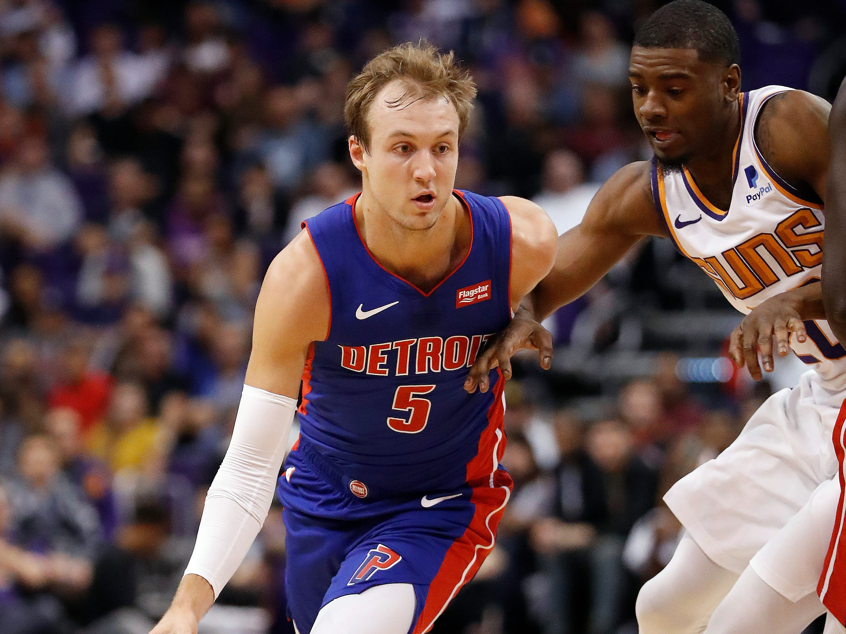 Detroit Pistons guard Luke Kennard (5) dries against the Phoenix Suns during the first half of an NBA basketball game, Thursday, March 21, 2019, in Phoenix.