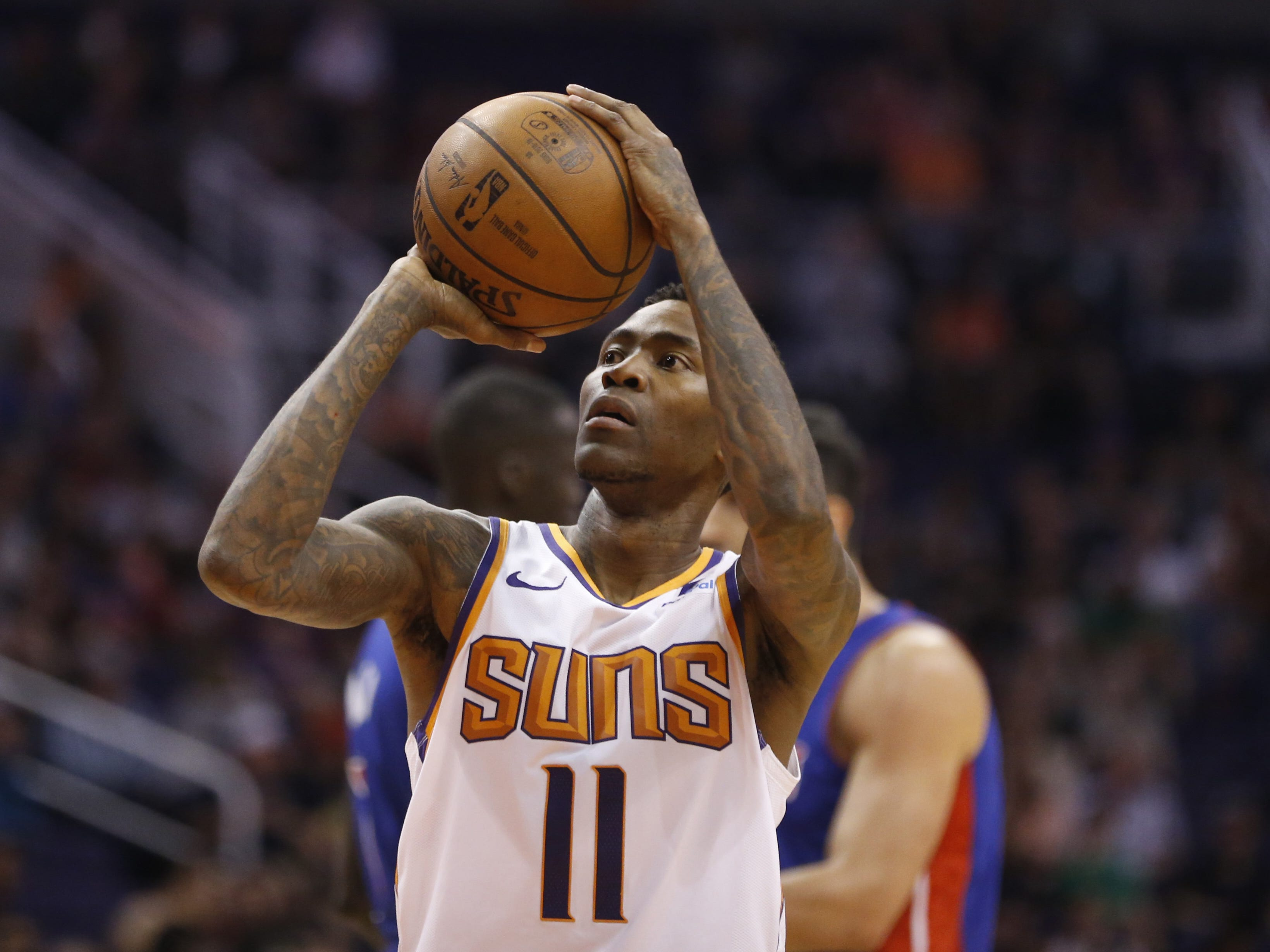 Suns' Jamal Crawford (11) shoots a technical free throw during the first half against the Pistons at the Talking Stick Resort Arena in Phoenix, Ariz. on March 21, 2019.