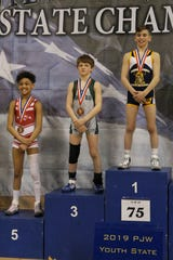 Aaron Seidel, middle, placed third in his weight class at the Pennsylvania Junior Wrestling Championships last weekend.