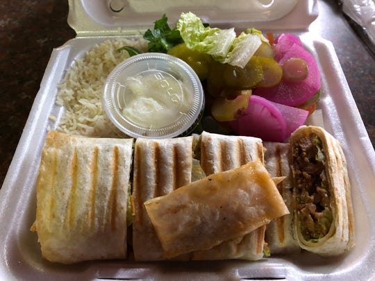 A huge chicken shawarma platter with white rice and a side salad from Olive Oil Mediterranean Restaurant in the Lebanon Farmers Market.