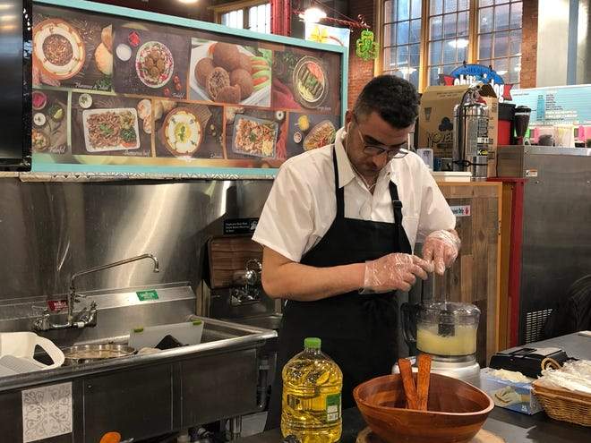 Mohammed Shaltaf, owner of Olive Oil Mediterranean Restaurant in the Lebanon Farmers Market, is hard at work preparing some chicken shawarma.